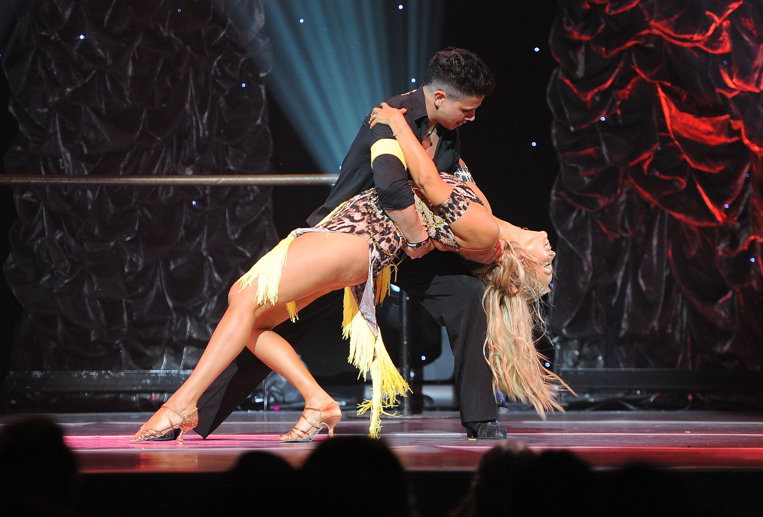 Dancer Jonathan Platero and Elizabeth Berkley performonstage at the 5th Annual Celebration of Dance Gala presented By The Dizzy Feet Foundation at Club Nokia. (All photosby Angela Weiss/Getty Images for Dizzy Feet Foundation.)