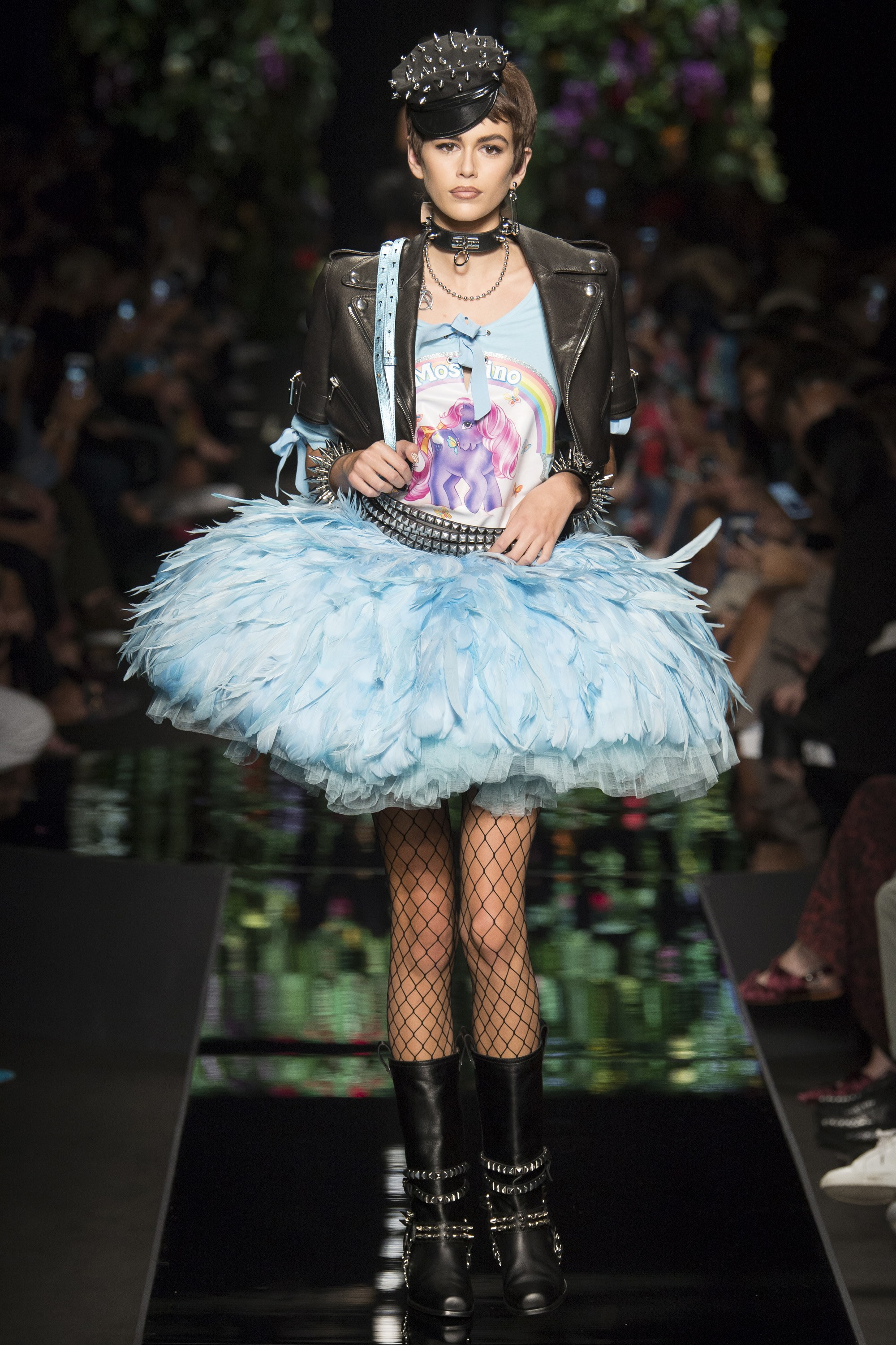 "Biker ballerinas were Scott's story on the runway: leather jackets, satin bustiers, tulle tutus, and fishnets in a couple dozen variations, with some DIY tees thrown into the mix. ""Shirt happens,"" one read. - VOGUE"