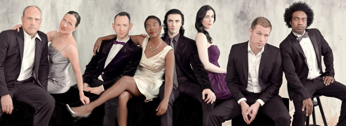 """Metro theaters go for the bold, ambitious and audacious this winter. It begins with """"Angels in America"""" at Actor's Express, with (from left)  Robert Bryan Davis, Carolyn Cook, Grant Chapman, Parris Sarter, Louis Greggory, Cara Mantella, Joe Sykes, Thandiwe DeShazor. Photo by Ashley Earles-Bennett."""