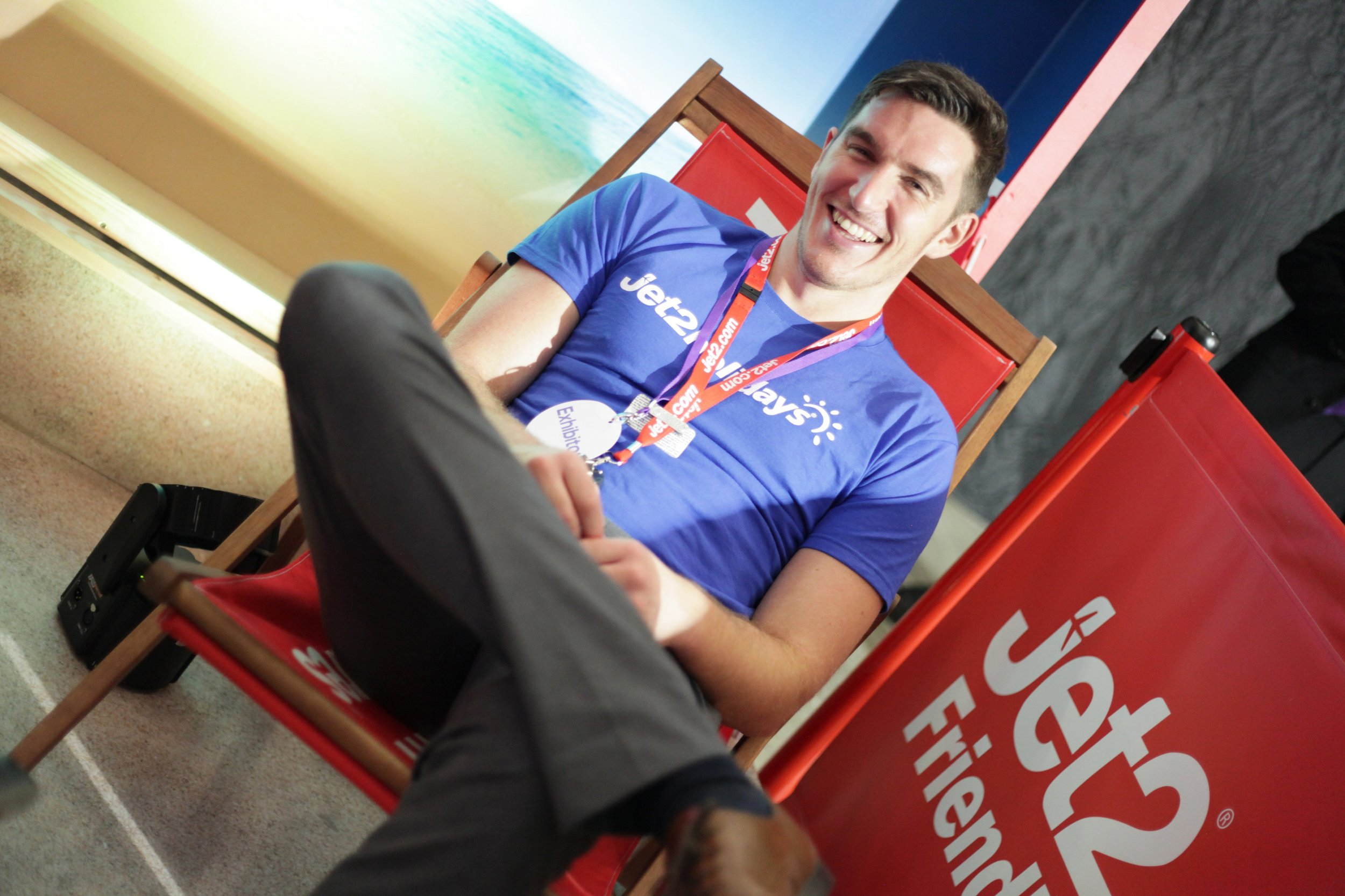 Johnathan Nicolson grabbing a quick rest at the busy Jet2.com and Jet2holidays stand