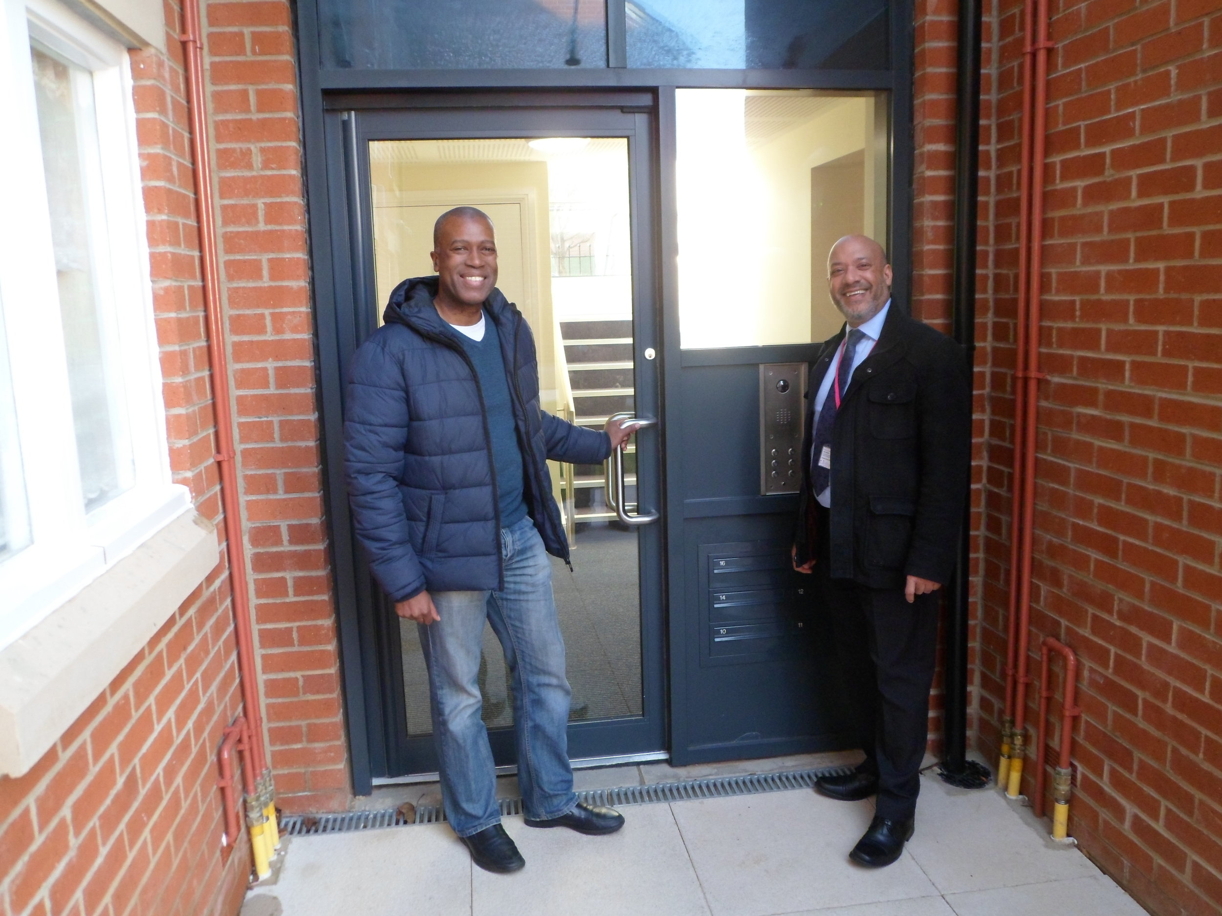 Unity chief executive Ali Akbor (right) with tenant Ian Bailey at the new Holborn Court development