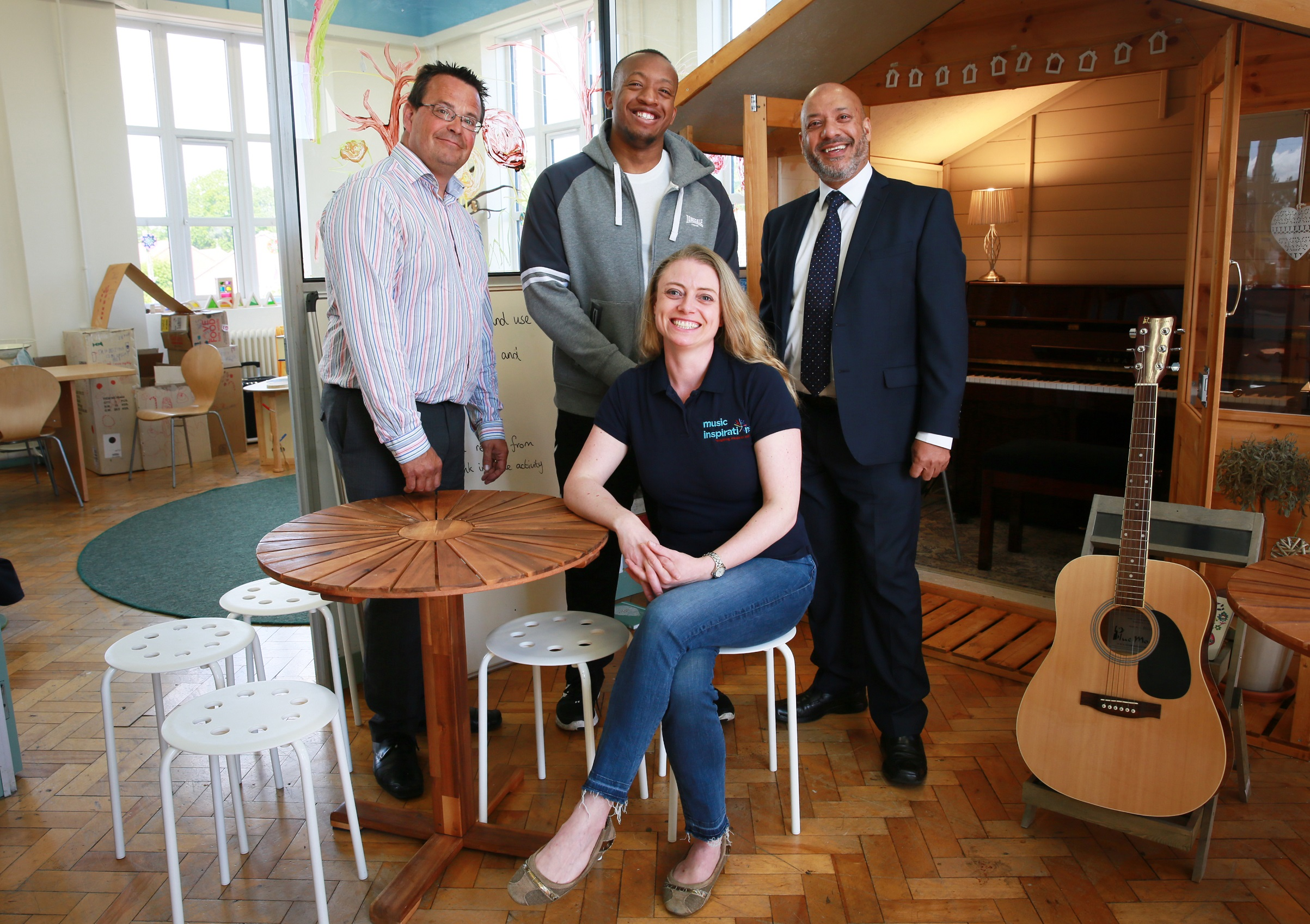 Inspirations Central owner Ruth Douglas welcomes (from left to right) Adrian Green(Unity Enterprise manager), Ali Akbor (Unity Homes and Enterprise chief executive) and Michael Kamara (C'Town Studio owner) to her new premises
