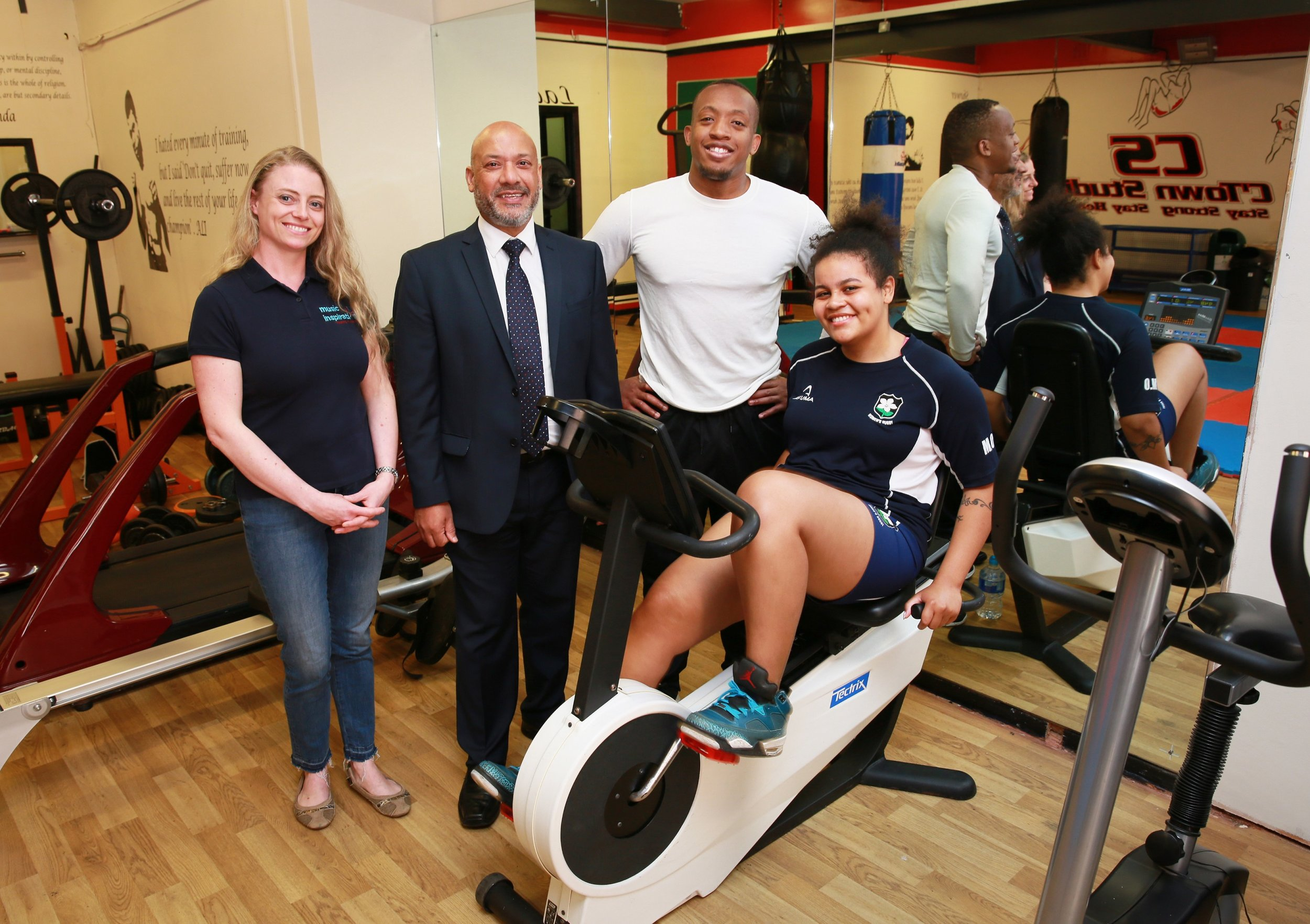Under the watchful eye of C'Town Studio owner Michael Kamara, Marie Obirigya passes on some workout tips to Inspirations Central owner Ruth Douglas and Unity Homes and Enterprise chief executive Ali Akbor