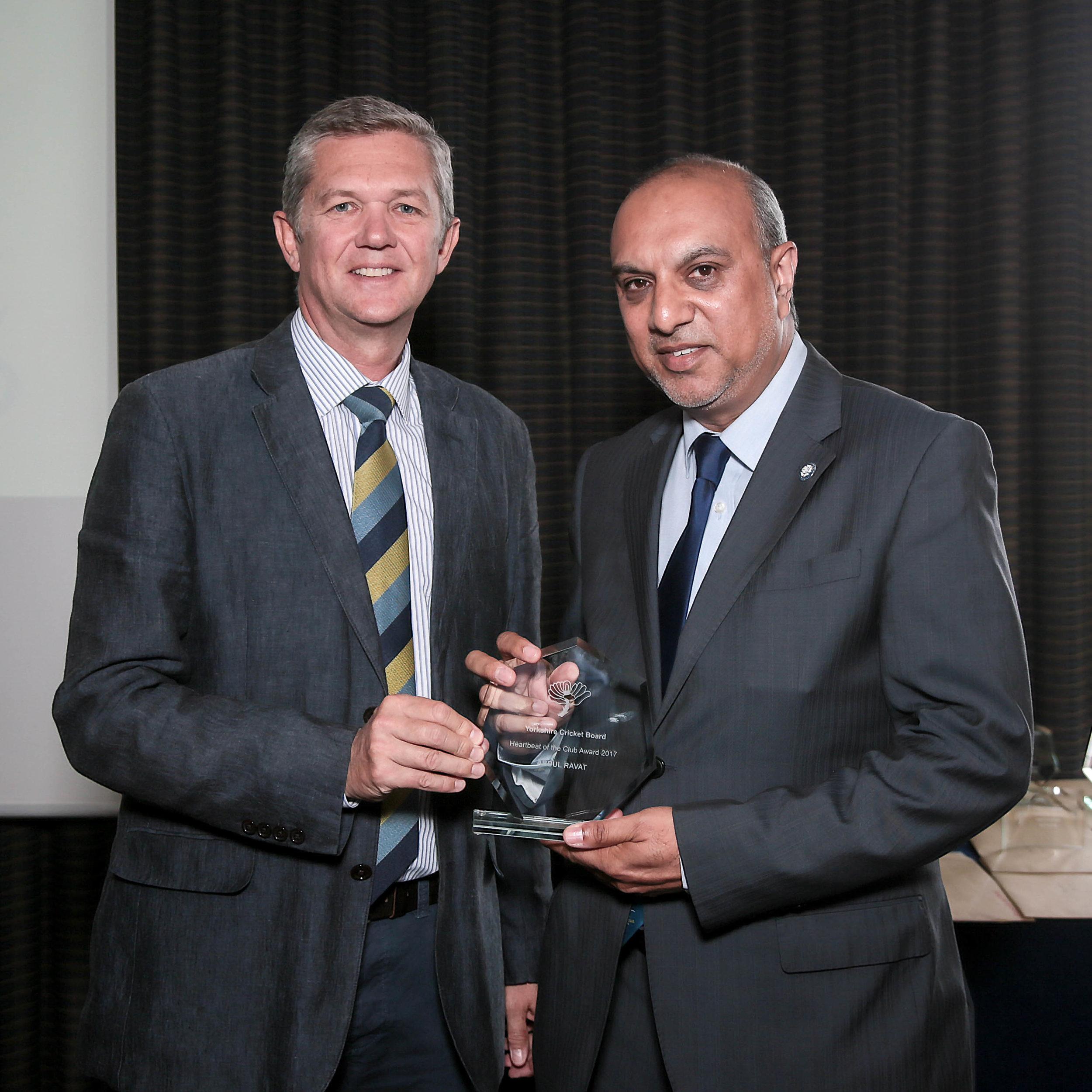 Yorkshire County Cricket Club chief executive Mark Arthur (left) presents Abdul Ravat with his Yorkshire OSCA