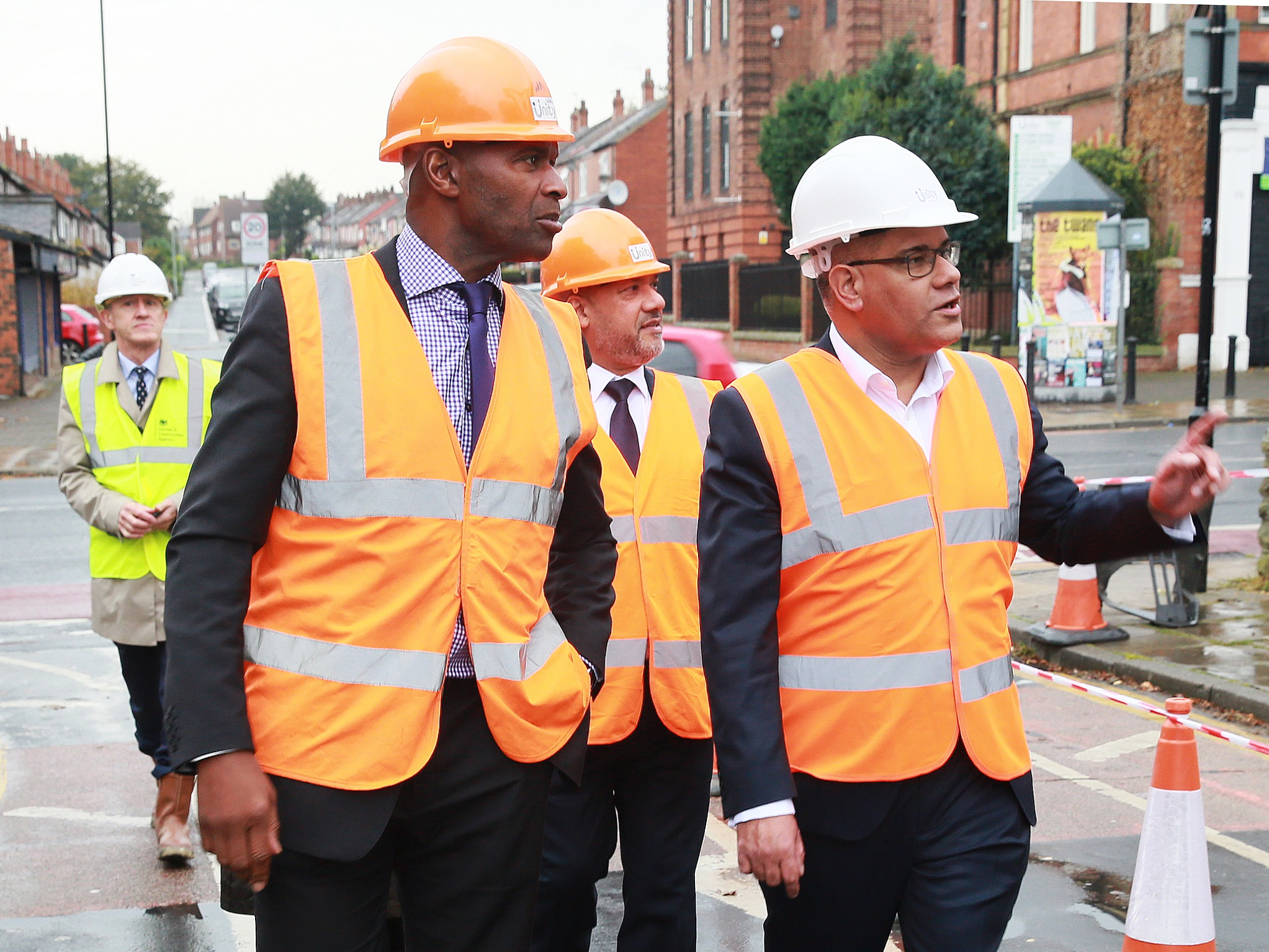 From right to left: Housing and Planning Minister Alok Sharma, Unity chief executive Ali Akbor and Unity regeneration director Wayne Noteman arrive at the soon-to-be-completed 146 Chapeltown Road affordable homes development in Leeds