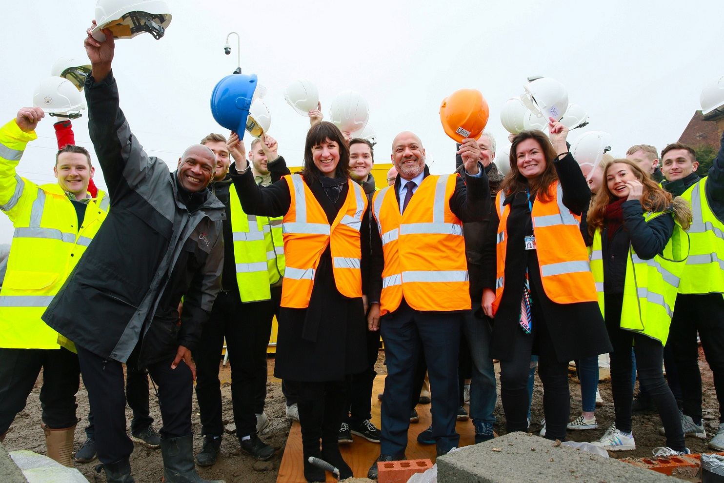 Leeds West MP Rachel Reeves (centre) celebrating progress on the Armley Ridge Road site with Unity chief executive Ali Akbor (centre right), project partners and students from Leeds Beckett University