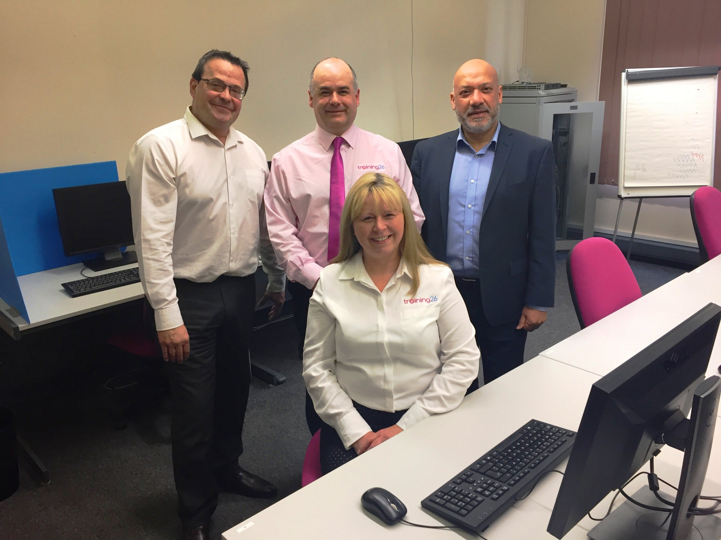 Training 26 Office Manager Angela Jones with (from right to left) Unity Homes and Enterprise Chief Executive Chief Executive Ali Akbor, Training 26 Director Mike Cunningham and Unity Enterprise Manager Adrian Green at Leeds Media Centre