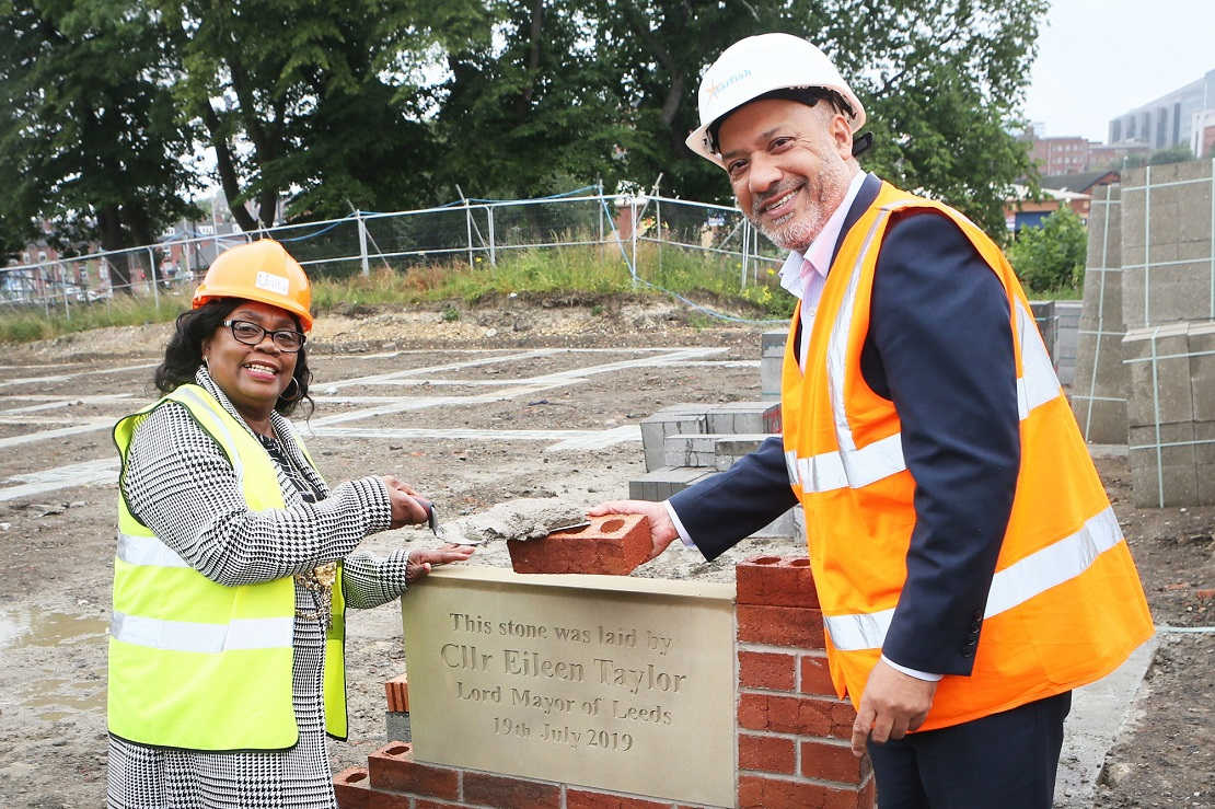 The Lord Mayor of Leeds, Cllr Eileen Taylor, lays the first stone at the Leopold Street development, assisted by Unity Chief Executive Ali Akbor