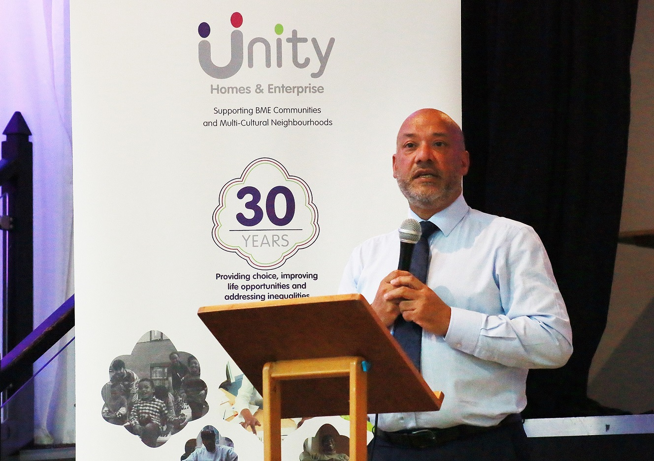 Unity Homes and Enterprise Chief Executive Ali Akbor addresses the association's AGM in 2018