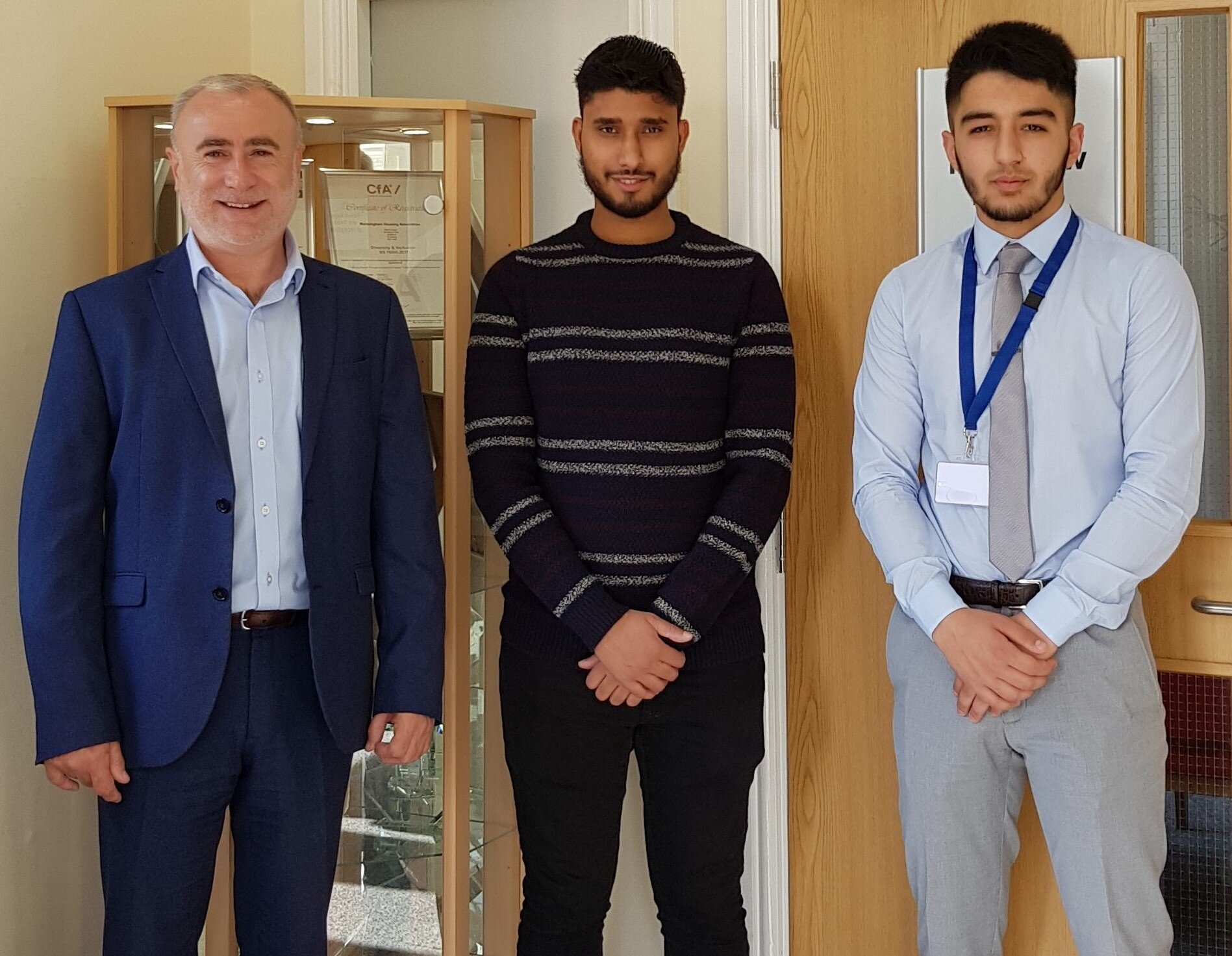 L to R: Lee Bloomfield, Manningham Housing Association Chief Executive, with apprentices Avtar Dhesi and Aanish Rehman