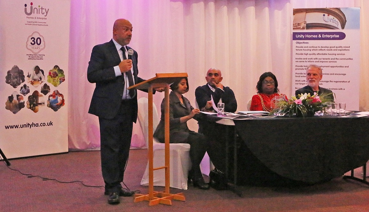 Unity Homes & Enterprise Chief Executive Ali Akbor delivers his annual address