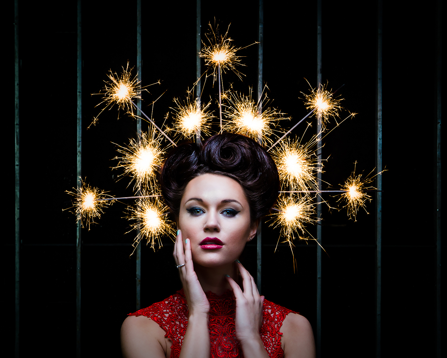 Fashion portrait with sparklers burning in models hair