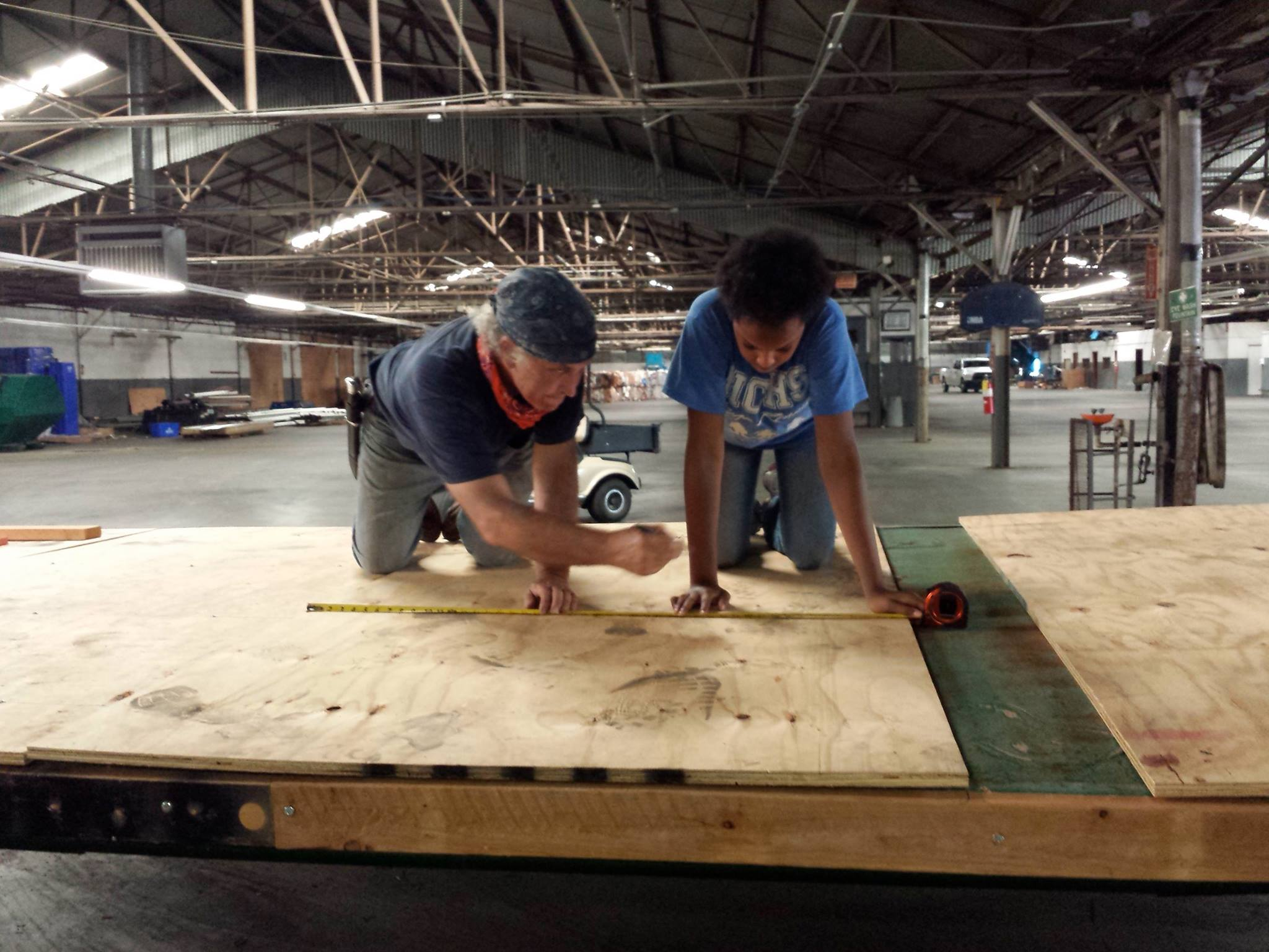 David and Aaliyah marking off where the screws need to go...