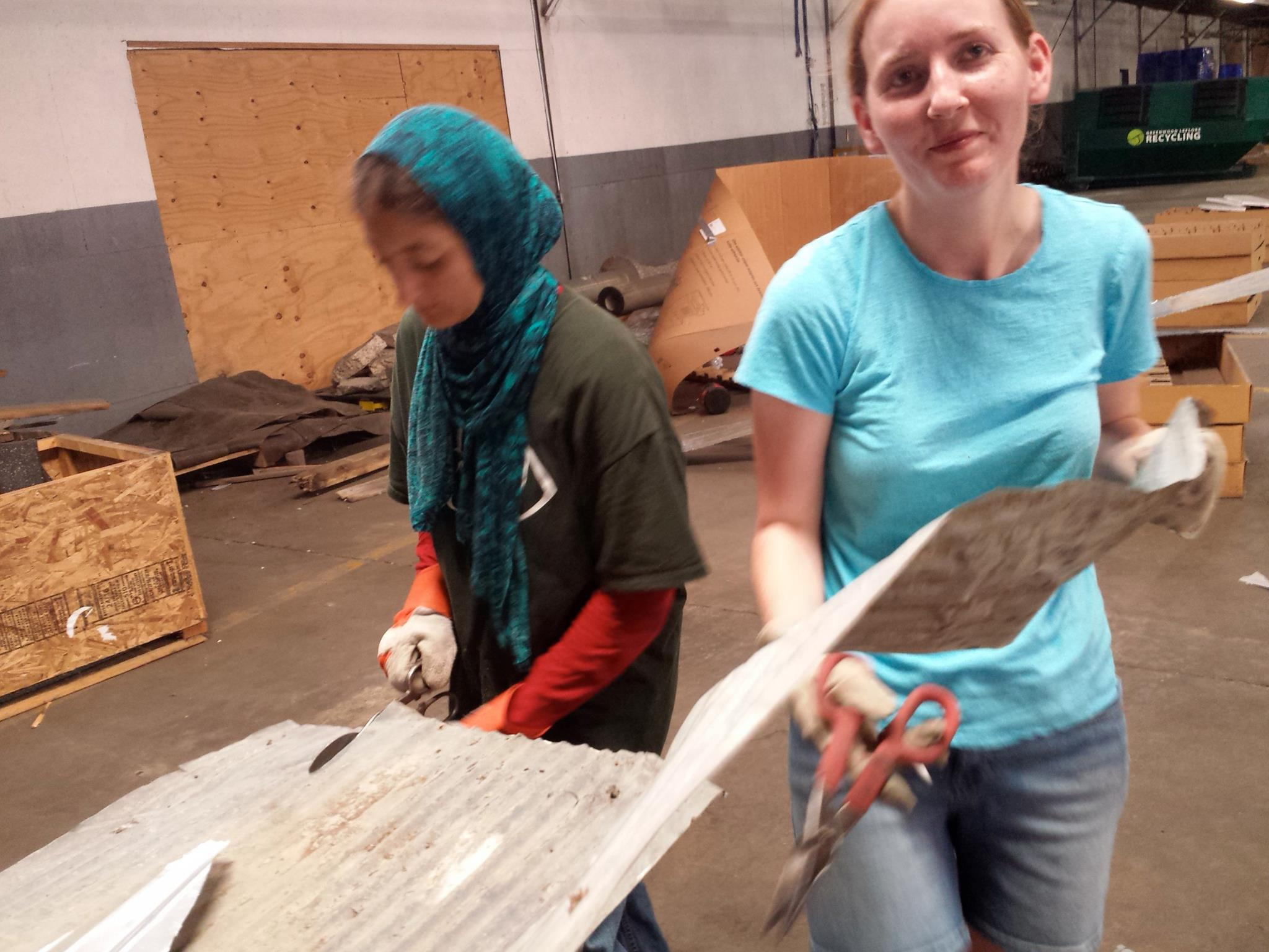 Thanks Nada Aziz and Alicia Pernell Dallas for your patience with the most tedious task of the week - cutting corrugated tin.
