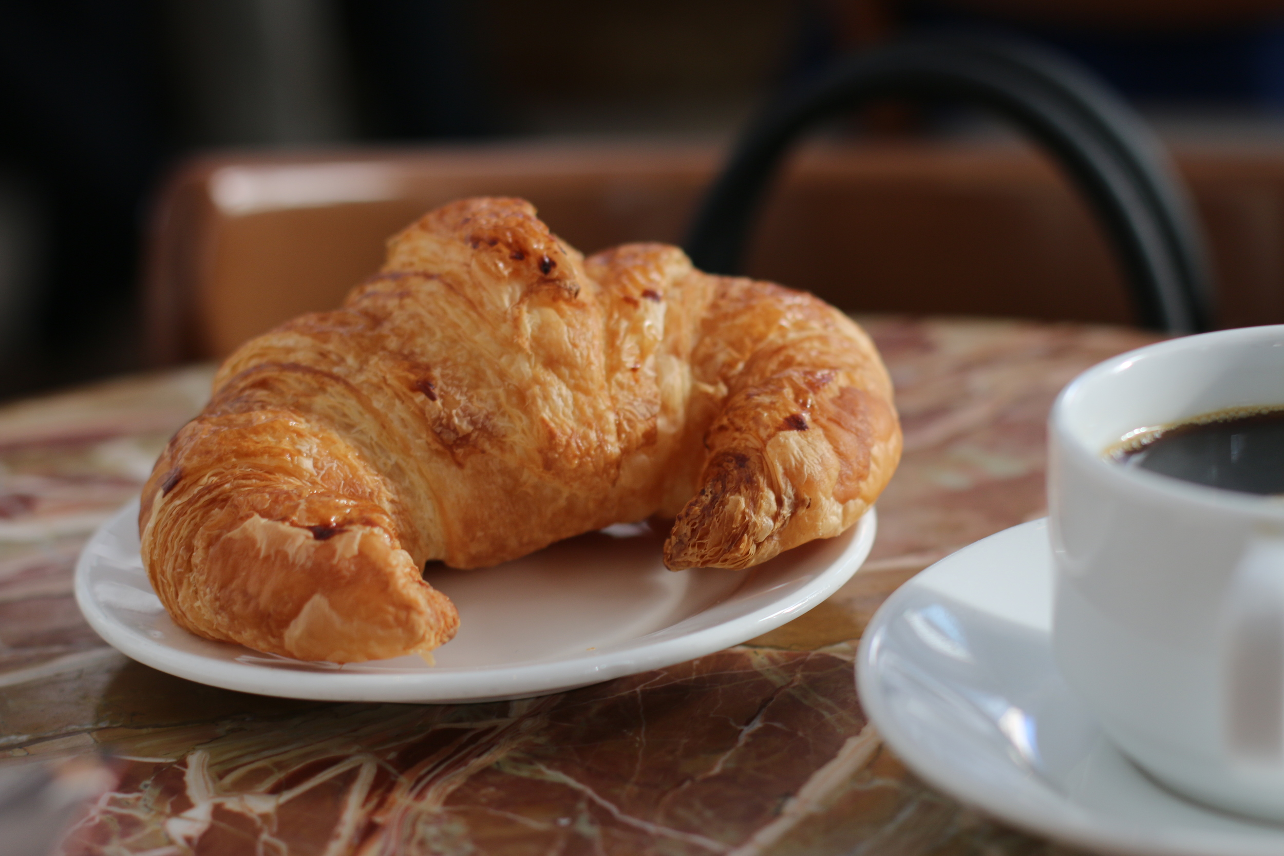 Getting croissant crumbs in between all the pages of your book? Worth it.