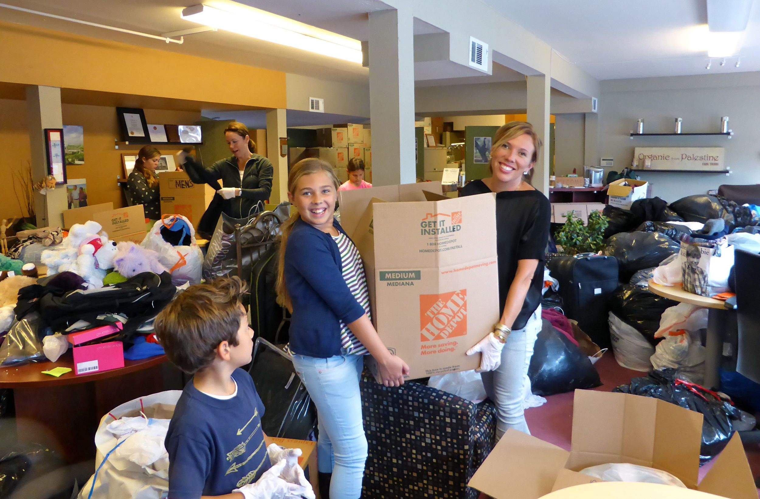 Hundreds of donations, volunteers came to sort, pack copy.jpg