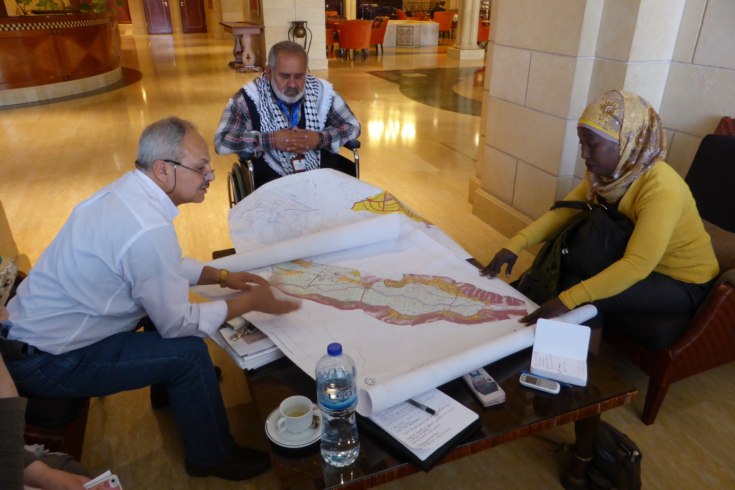 Haj Sami Sadeq, mayor of Al Aqaba, and a village council member from another village, meet with Dr. Rassem Khamaisi, professor at Haifa university and planner with the International Peace and Cooperation Center.