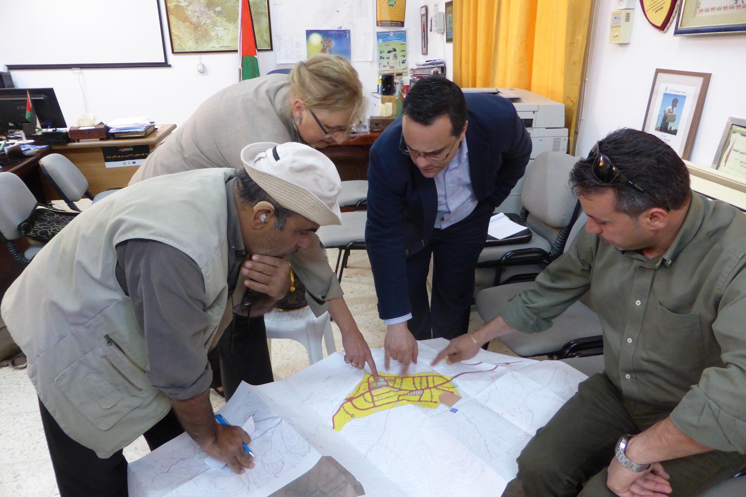 Donna Baranski-Walker with villagers discussing al Aqaba village's master plan.