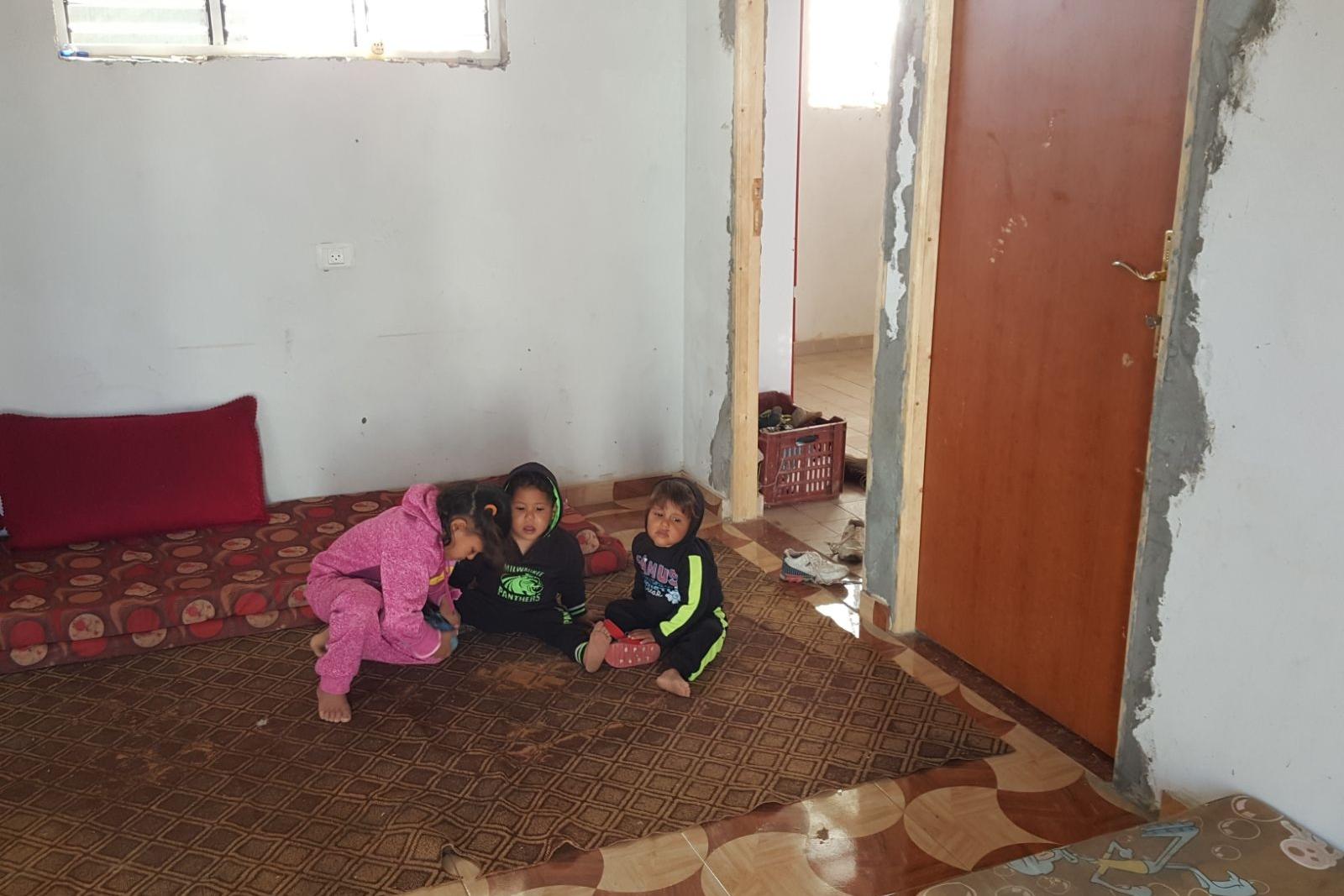 Three of Abeer's children in their cement home.