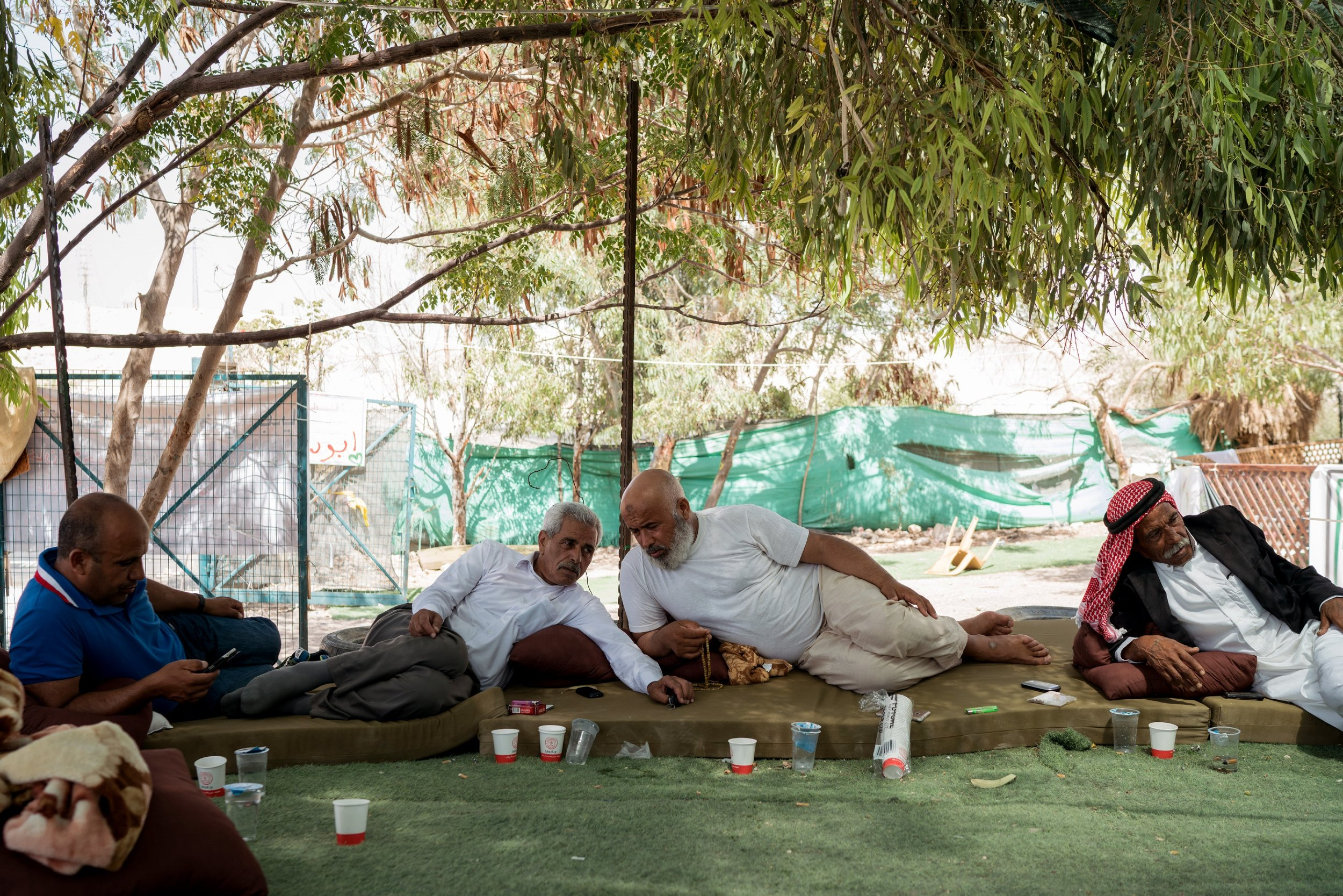 Palestinian Bedouin men sit together in Khan al-Ahmar on July 26, 2018. Photo: Samar Hazboun for The Intercept