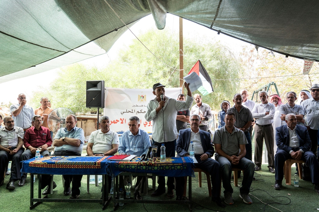 Eid Abu Khamis, center, speaks during a press conference in Khan al-Ahmar on July 26, 2018. Photo: Samar Hazboun for The Intercept