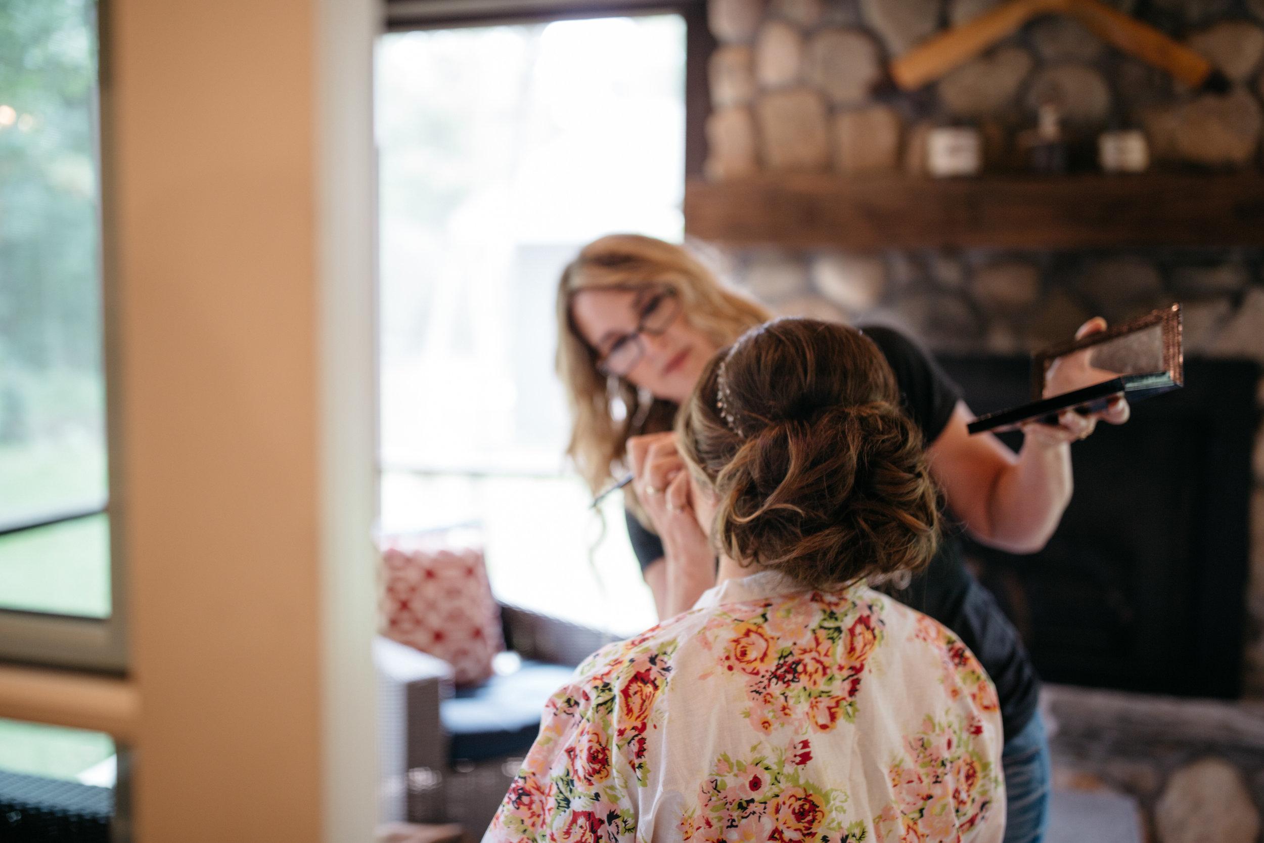 Bride getting ready at Grand View Lodge cabin. Wedding photography by Britt DeZeeuw, Brainerd photographer