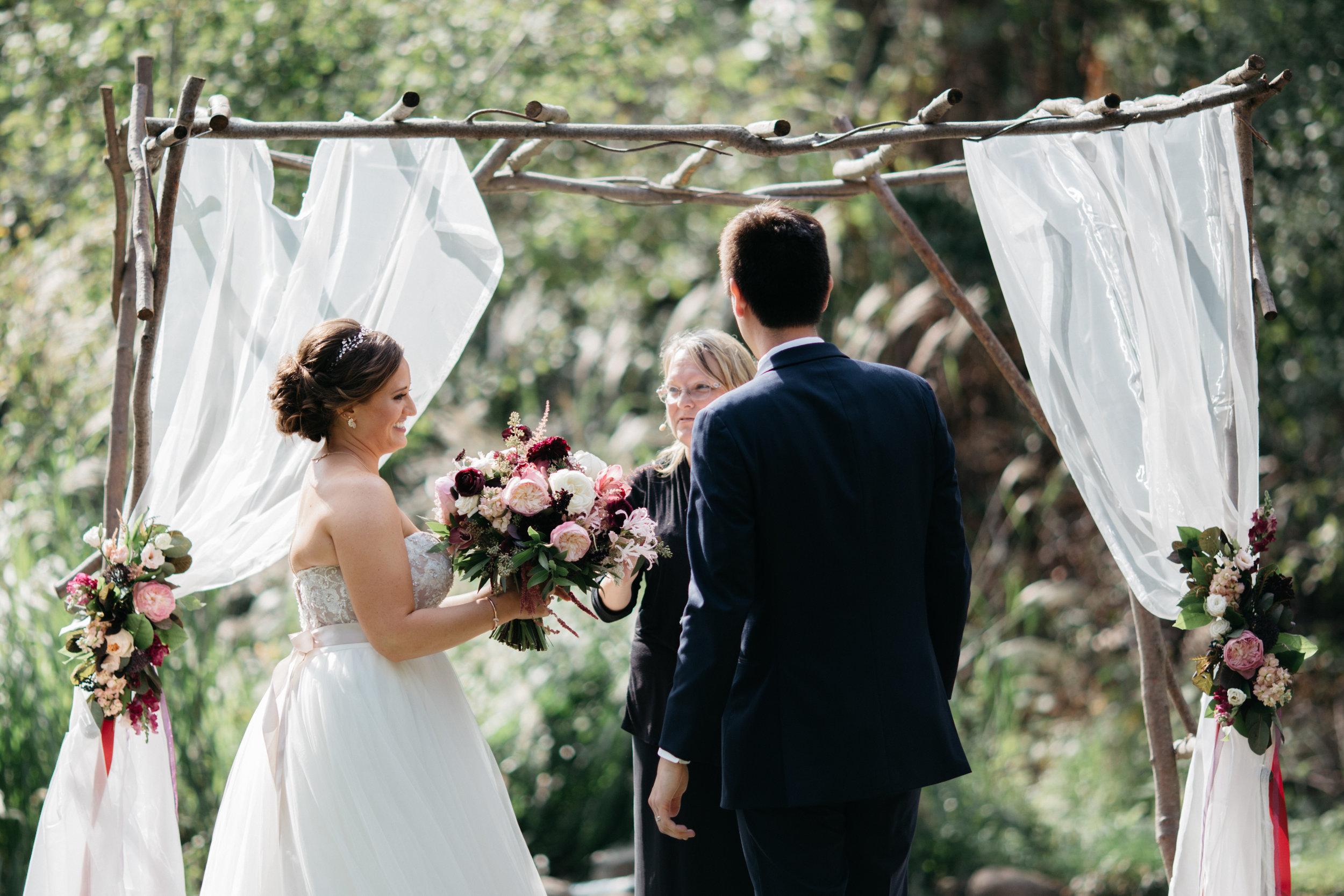 Vineyard wedding ceremony at Grand View Lodge. Photography by Britt DeZeeuw.