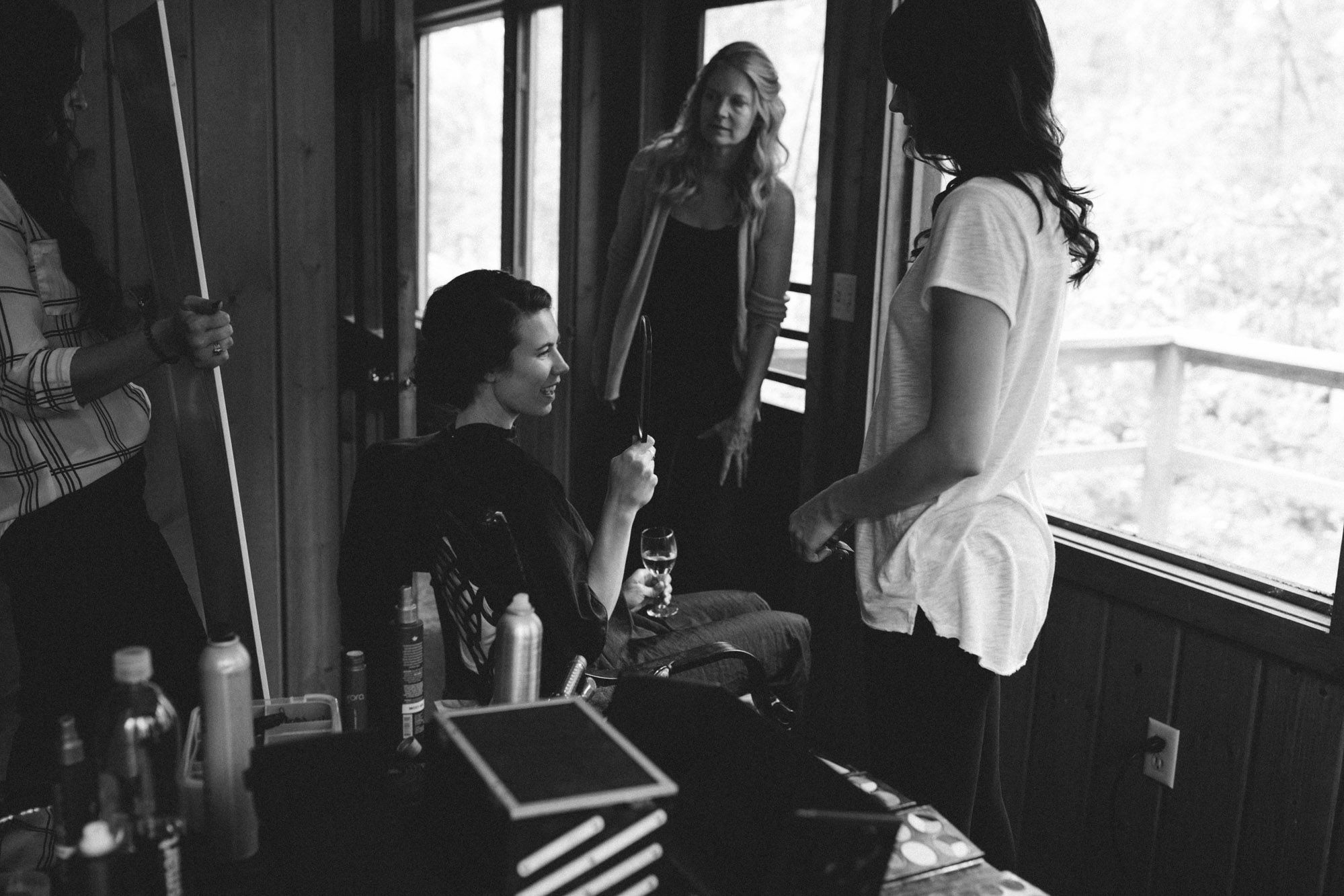 Bride getting ready, as mom watches, on wedding day at Grand View Lodge on Gull Lake