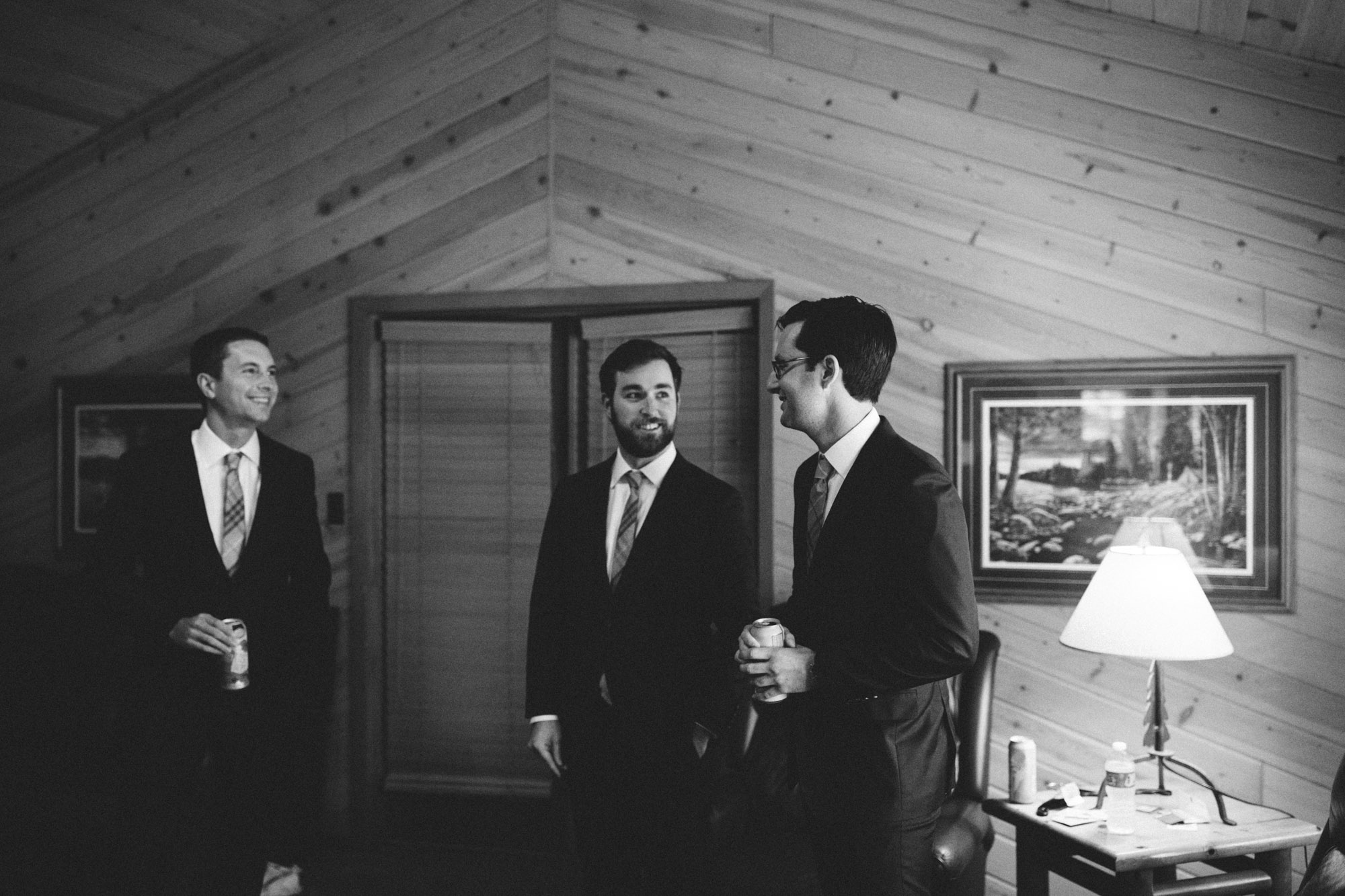 Groom and groomsmen in cabin at Grand View Lodge. Photography by Britt DeZeeuw, Brainerd Minnesota photographer.