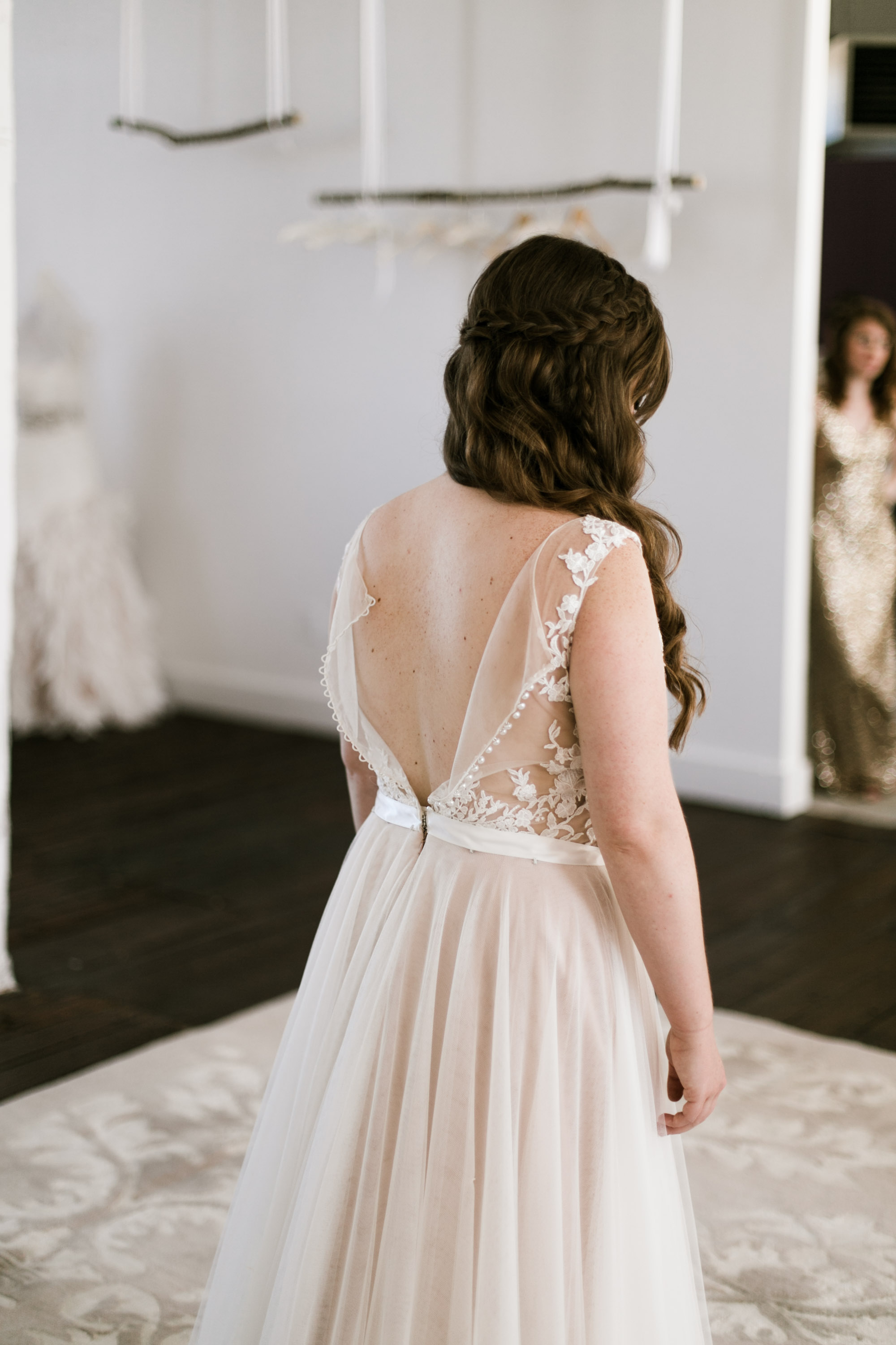 Bride getting into wedding dress at the NP Event Space, photography by Britt DeZeeuw.