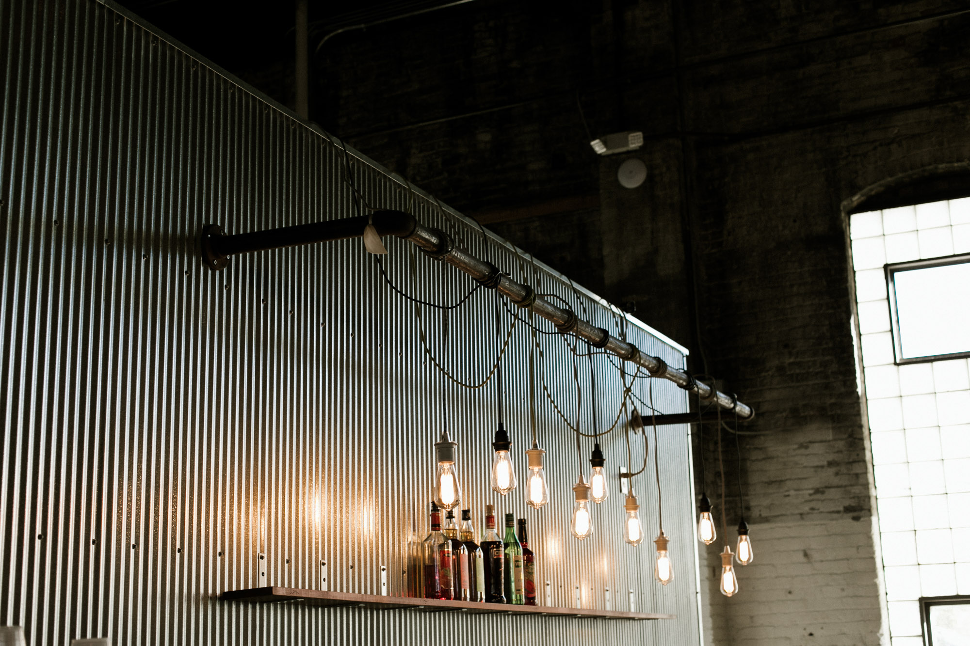 Industrial lighting wedding decor at the NP Event Space, photography by Britt DeZeeuw