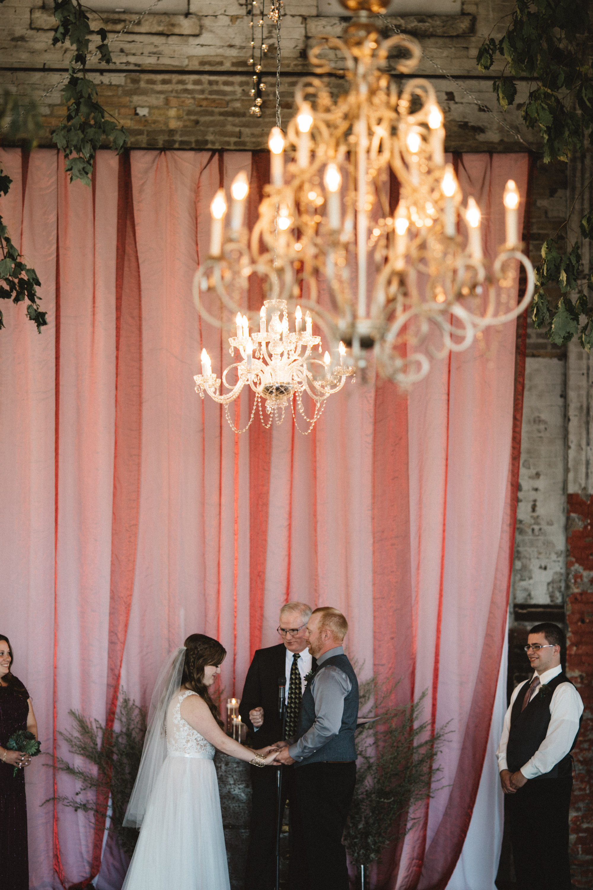 Indoor warehouse wedding ceremony at the NP Event Space. Photography by Britt DeZeeuw