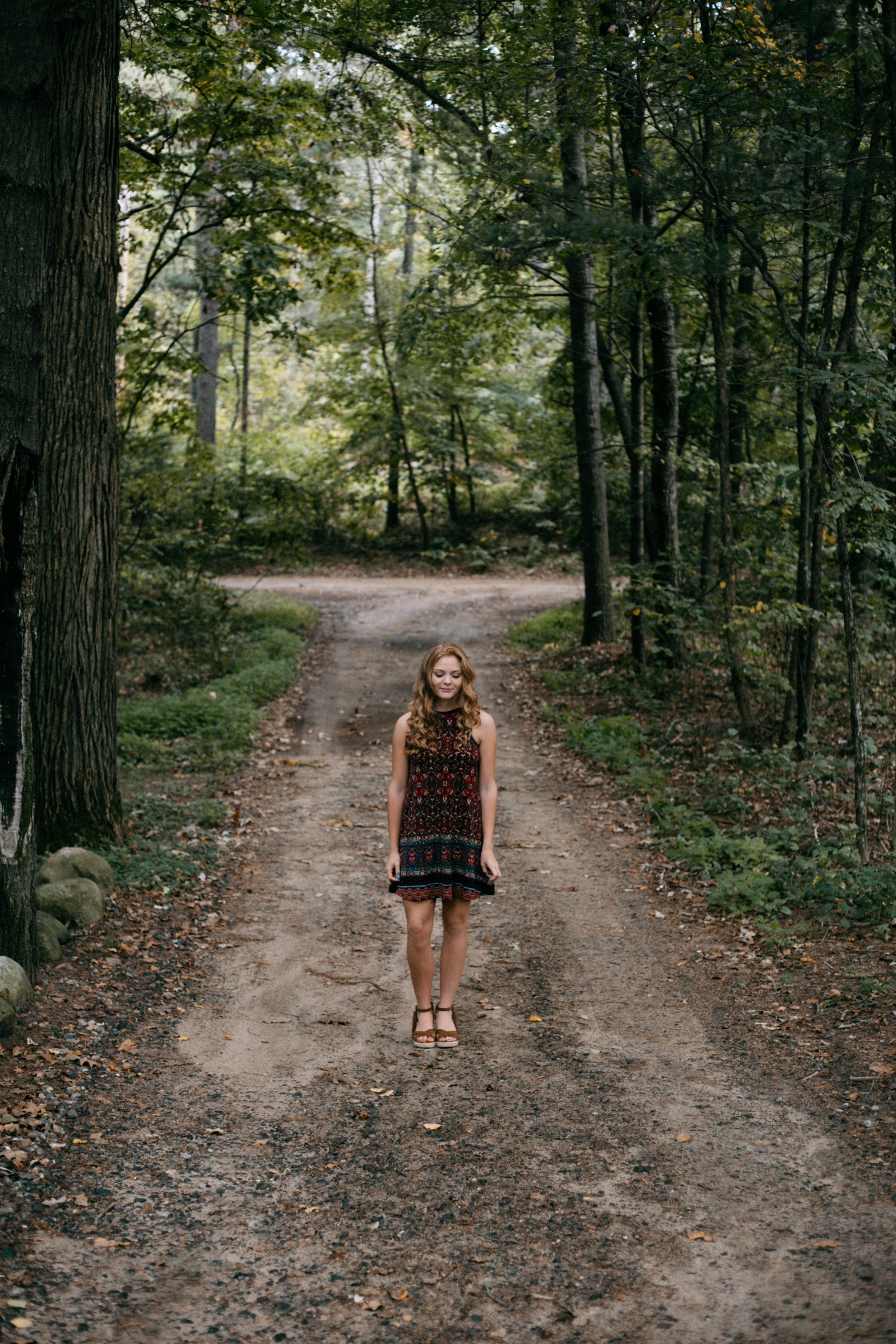High school senior portrait session in the woods in Brainerd Minnesota by Britt DeZeeuw