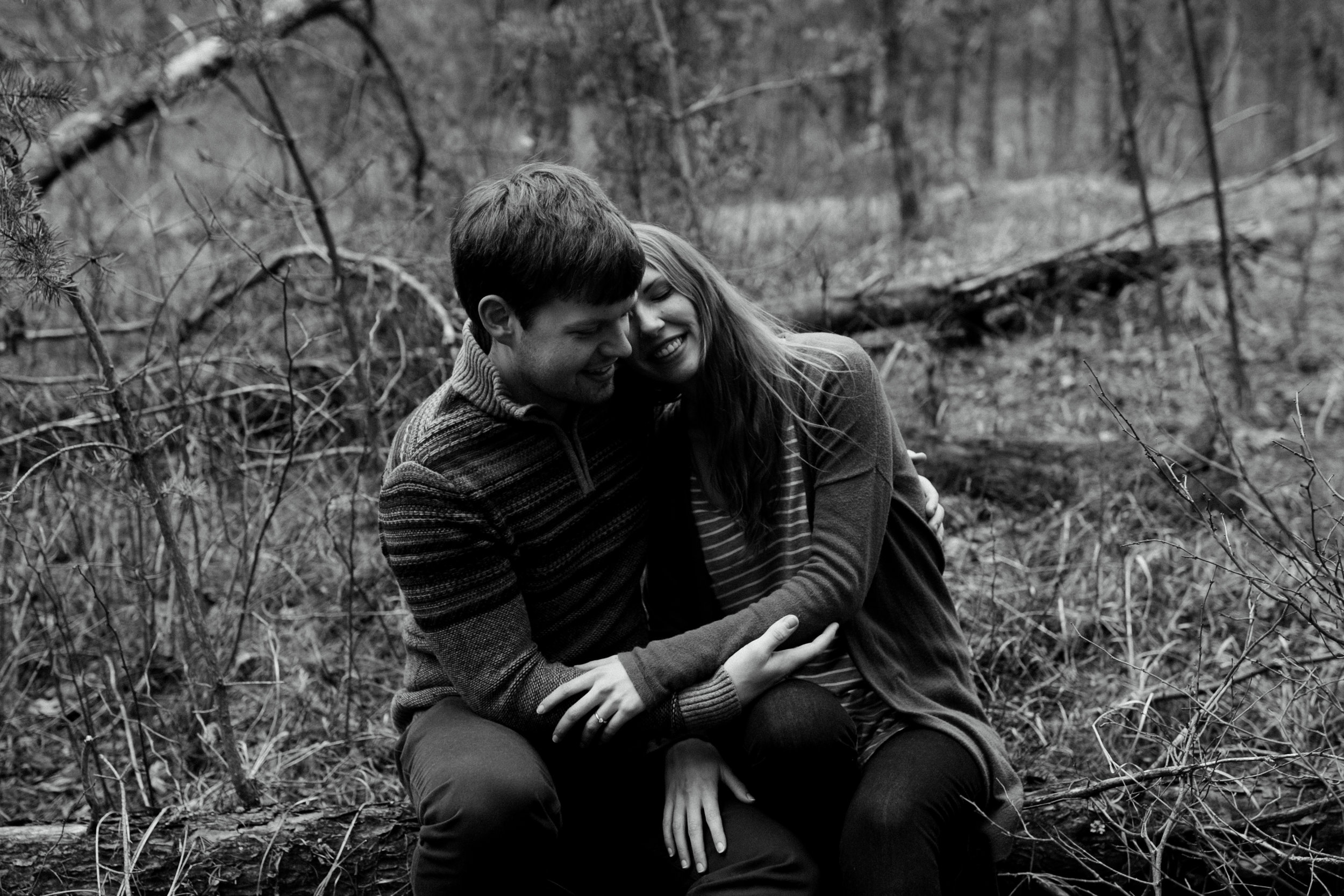 Emotionally raw engagement photography in the woods at the Northland Arboretum in Brainerd Minnesota, photographed by Britt DeZeeuw.