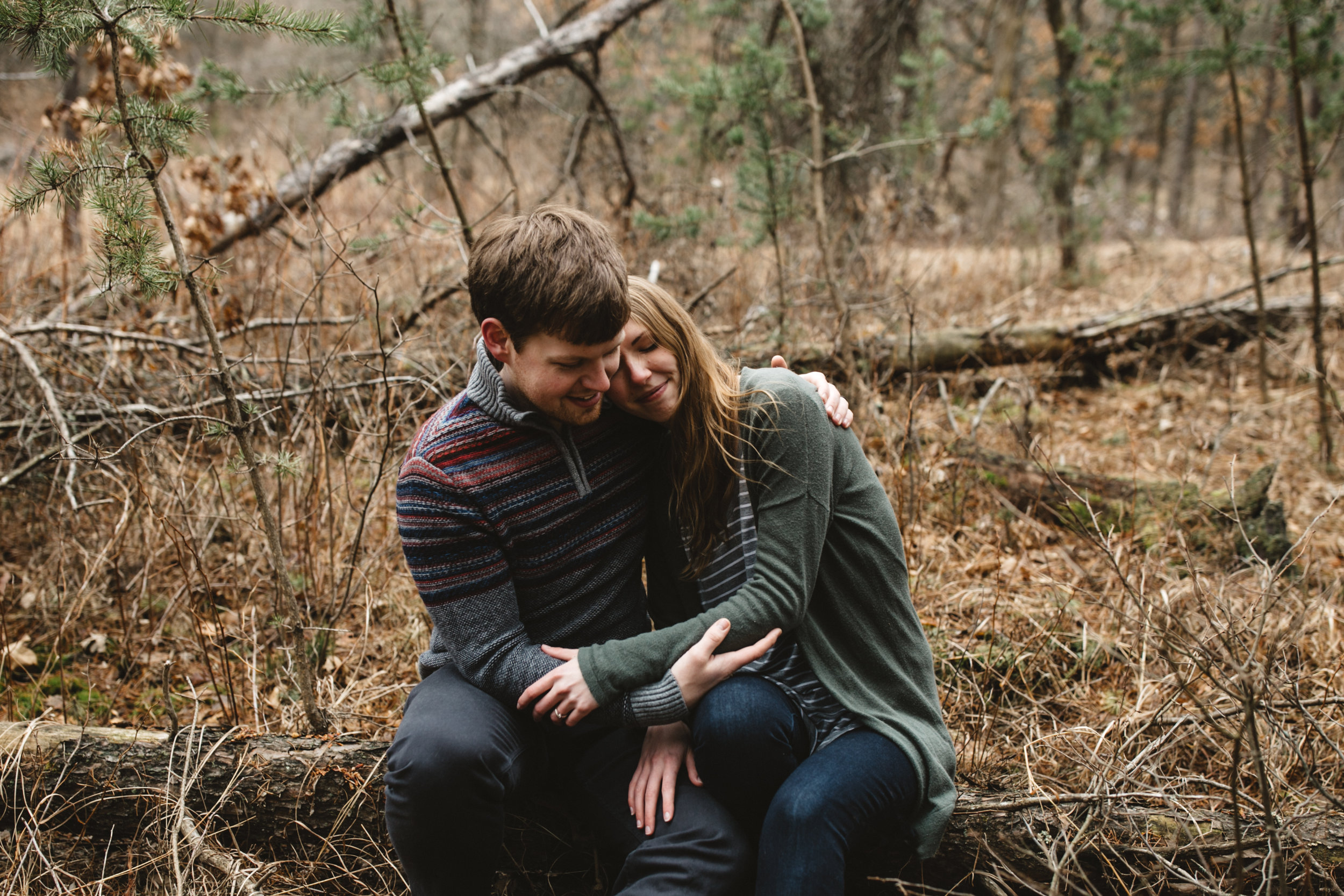 Intimate engagement session in the woods at the northland arboretum photographed by Britt DeZeeuw, Brainerd Minnesota wedding photographer