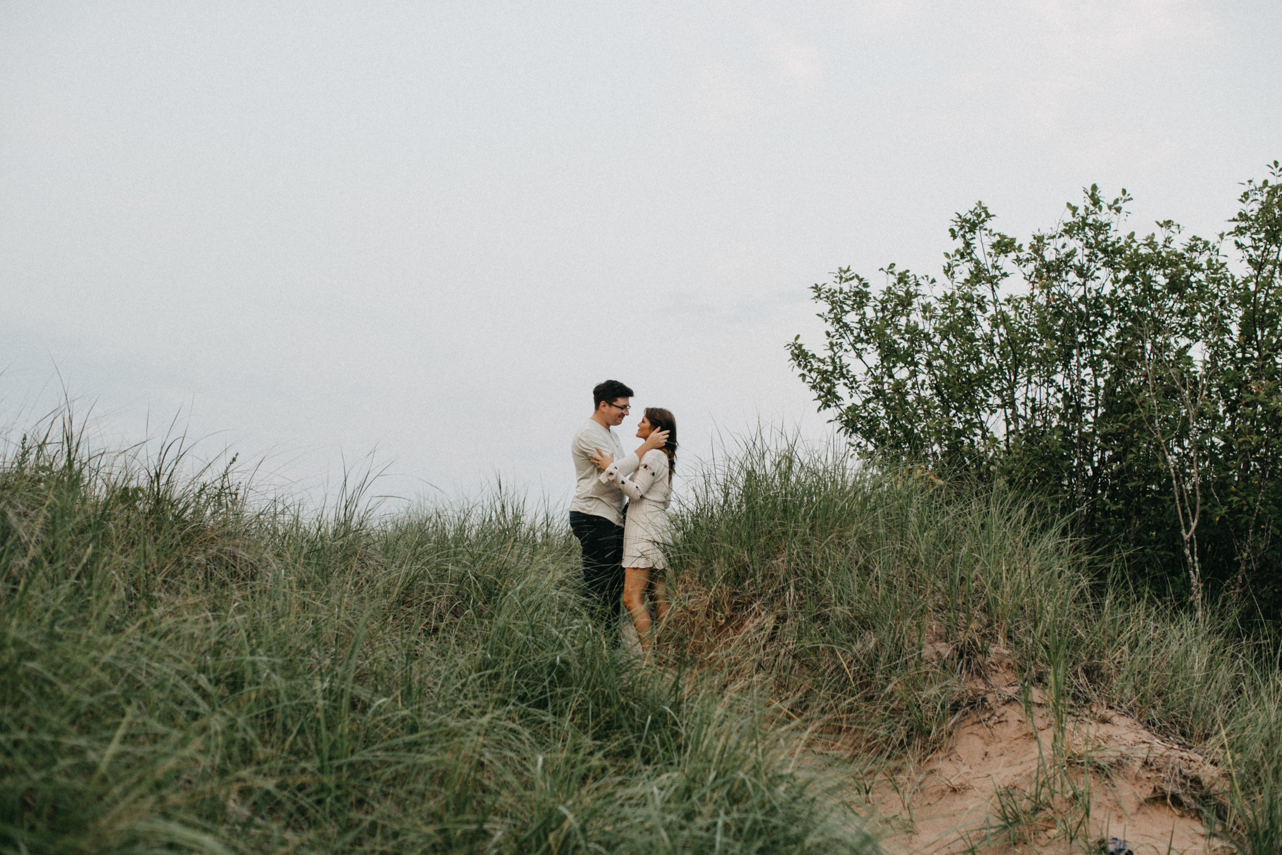 Intimate and emotional engagement photography on the north shore in Duluth Minnesota by Britt DeZeeuw