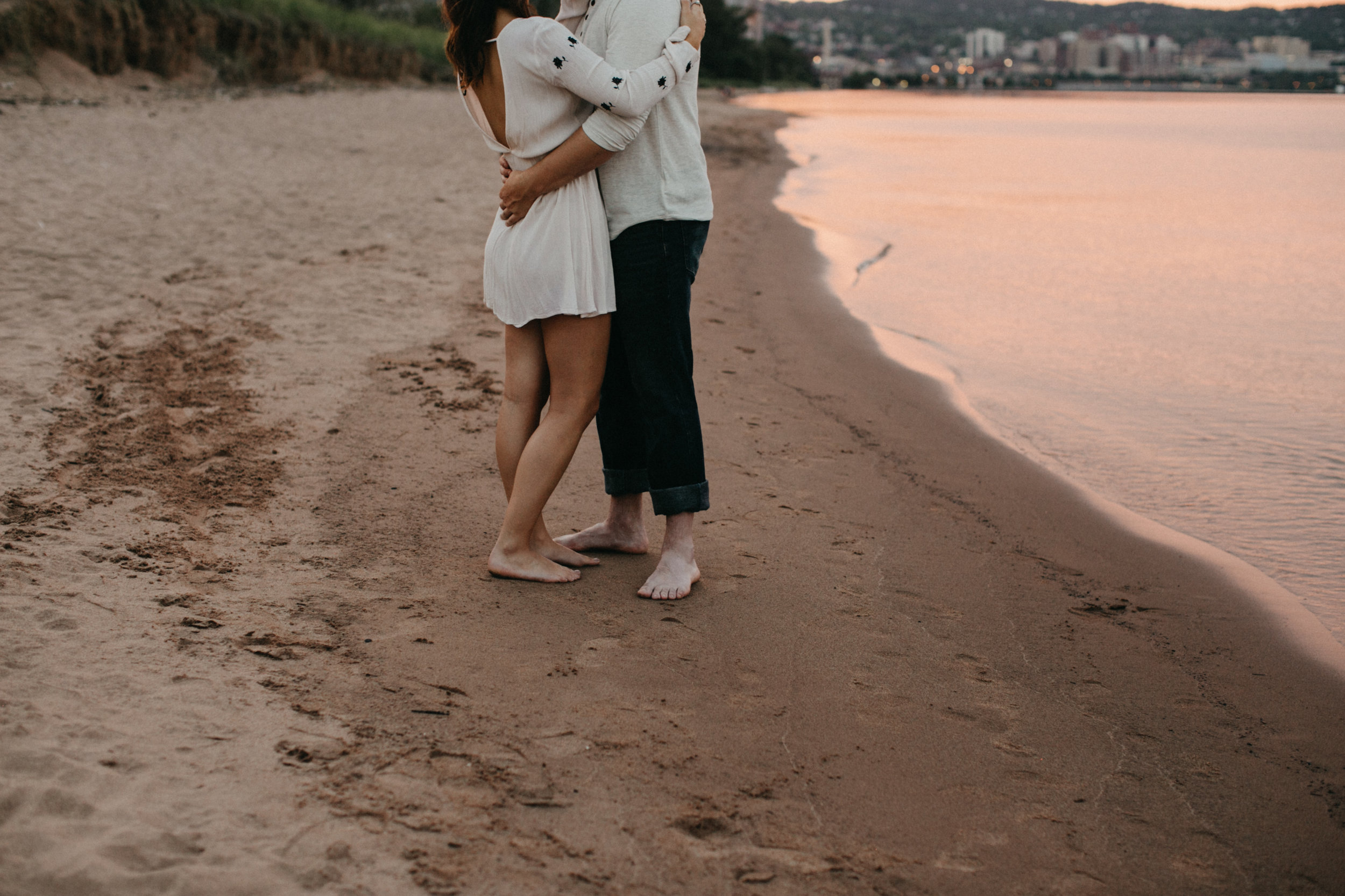 Intimate, dreamy sunset engagement photography on the beach in Duluth Minnesota