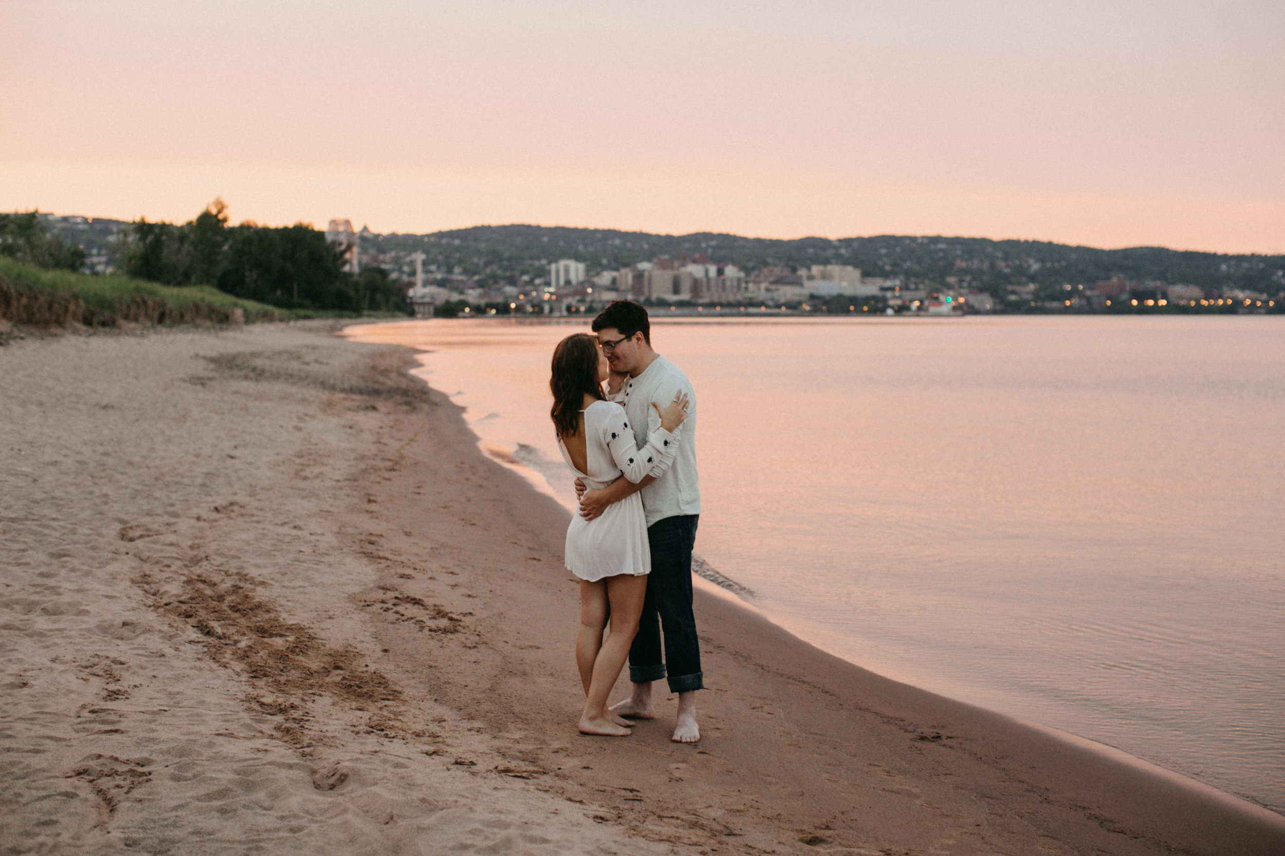 Breathtaking engagement session on the beach at sunset in Duluth Minnesota