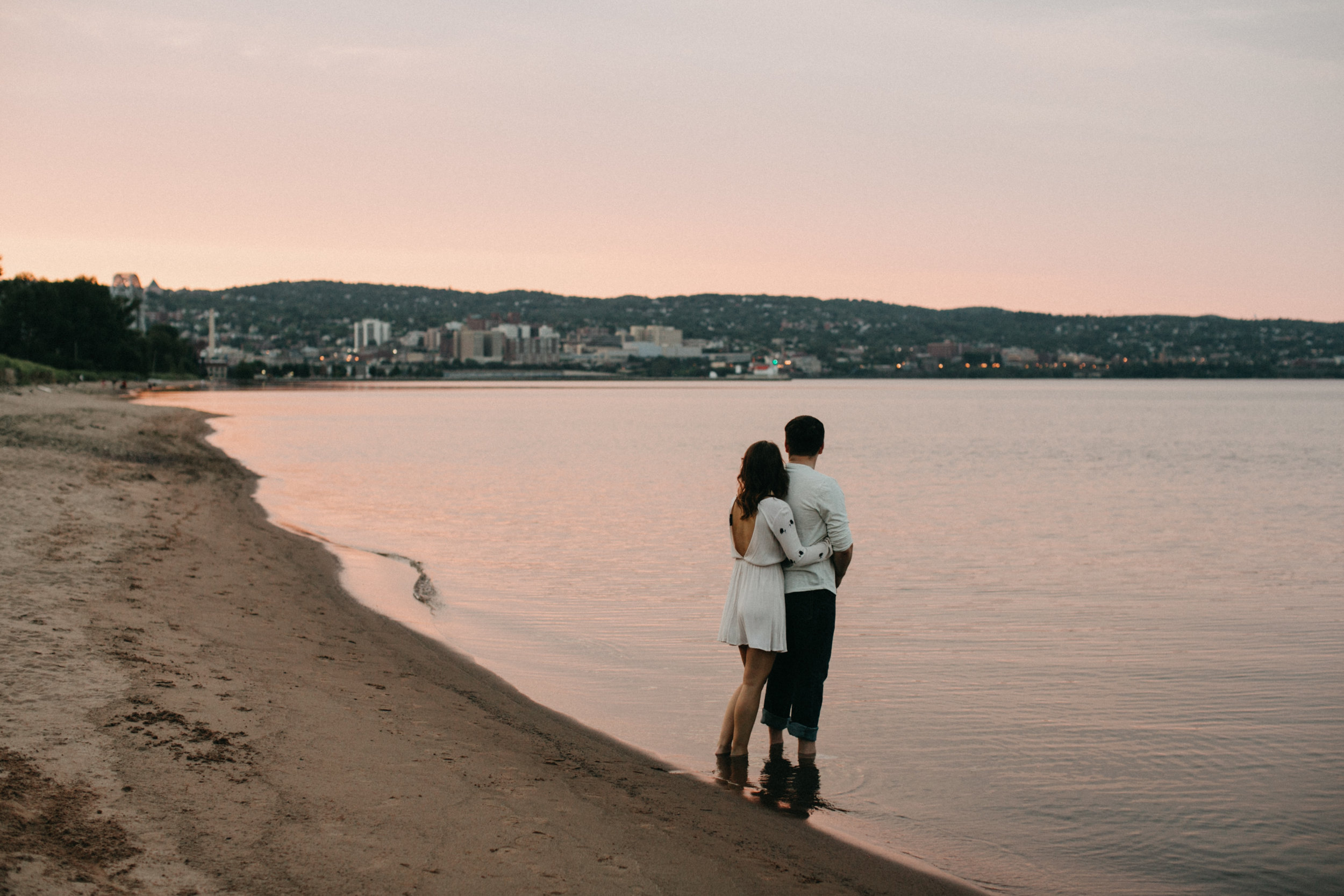 Romantic and moody engagement photography at Park Point Beach in Duluth Minnesota