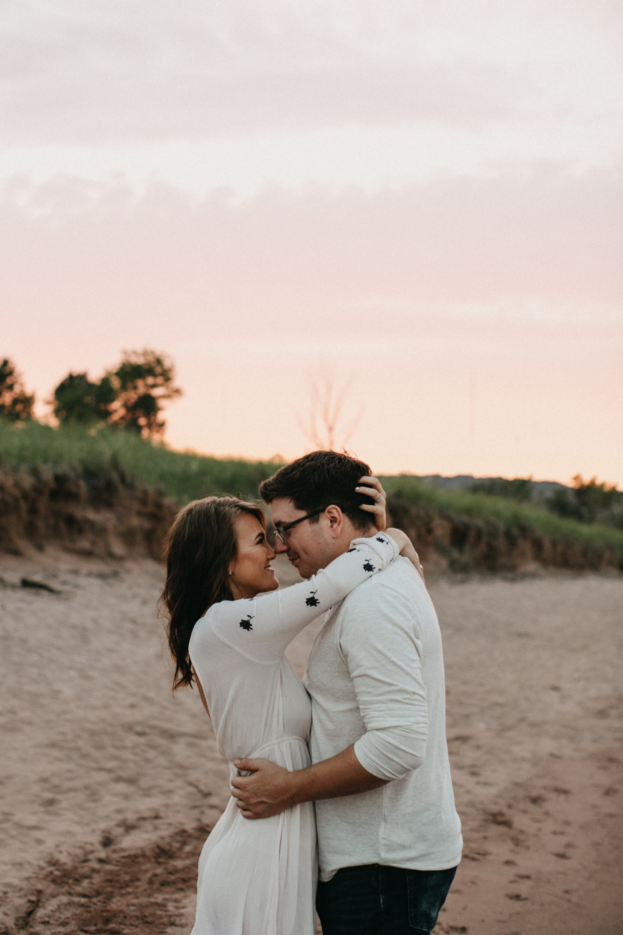 Beautiful sunset engagement session at Park Point Beach in Duluth Minnesota