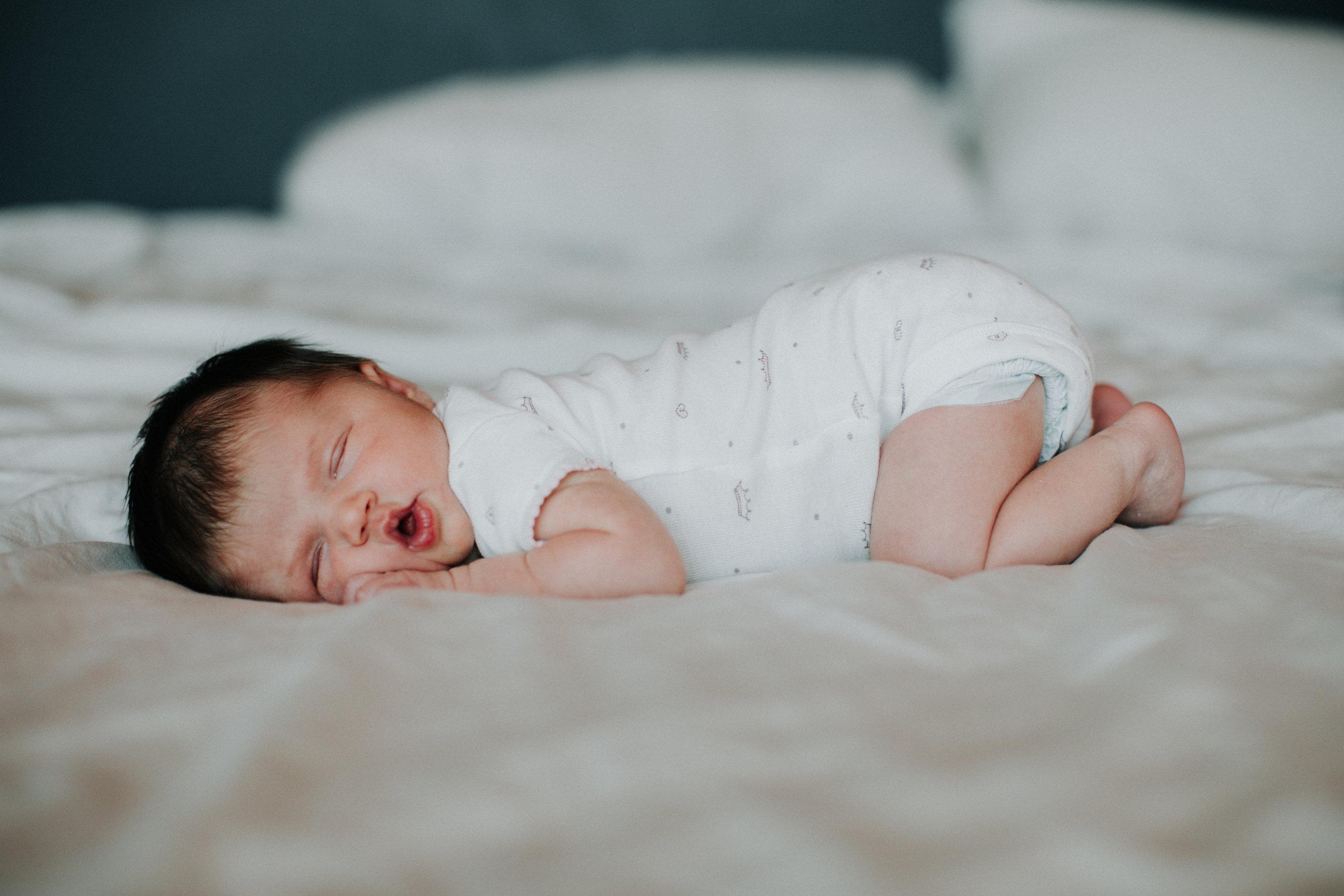 In home newborn baby girl session by Britt DeZeeuw, Brainerd Minnesota photographer