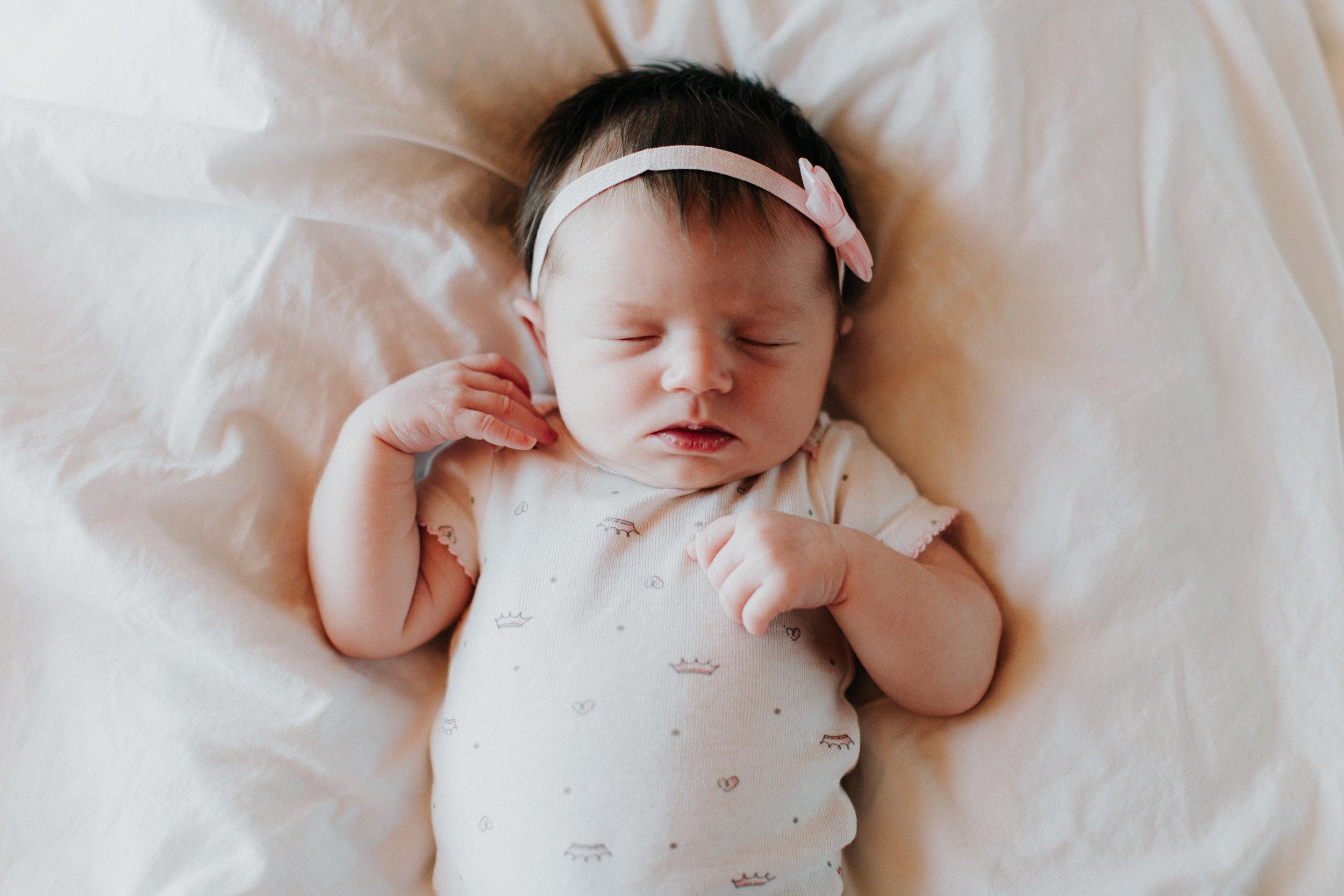 Baby girl photographed by Brainerd Minnesota newborn photographer Britt DeZeeuw