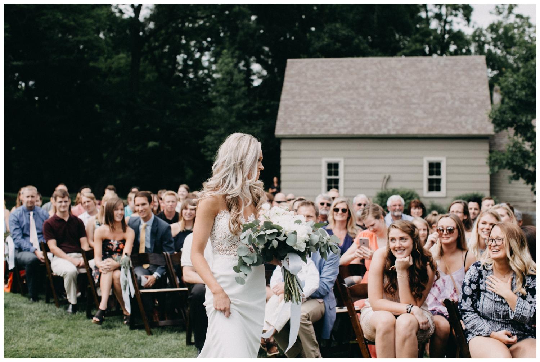 Documentary photography at outdoor Creekside Farm wedding ceremony by Britt DeZeeuw