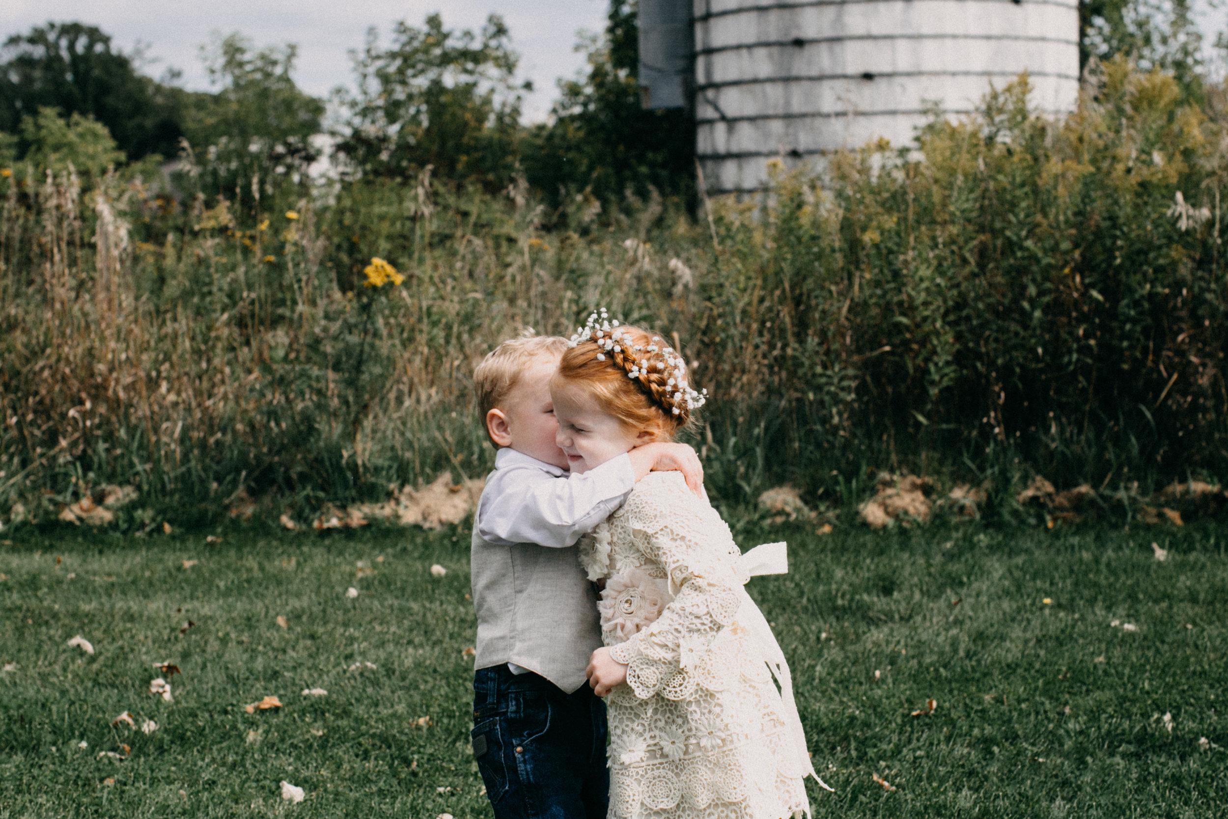 Adorable flower girl and ring bearer at barn wedding in Brainerd MN