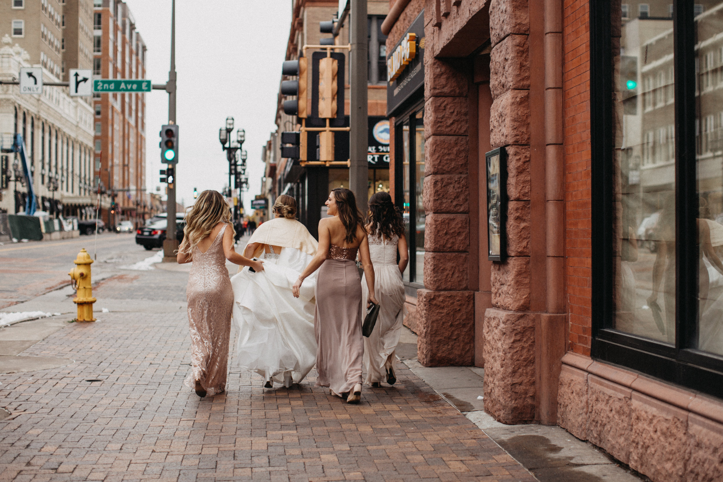 Bride with bridesmaids in downtown Duluth Greysolon wedding