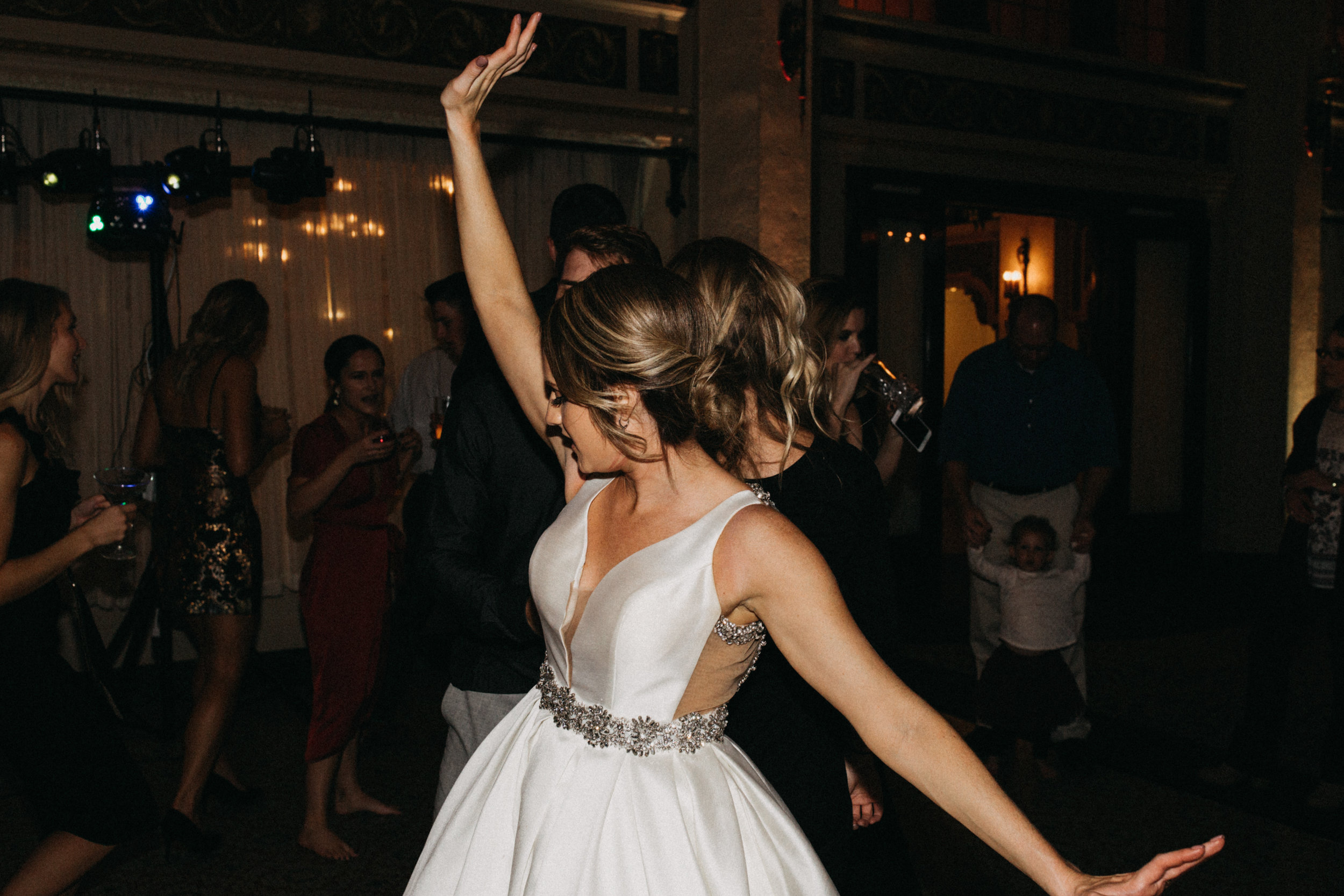 Bride dancing during wedding reception at the Greysolon in Duluth Minnesota