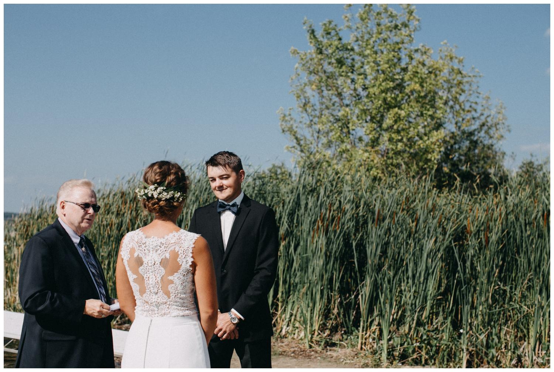 Destination beach wedding ceremony on the lake in Brainerd Minnesota