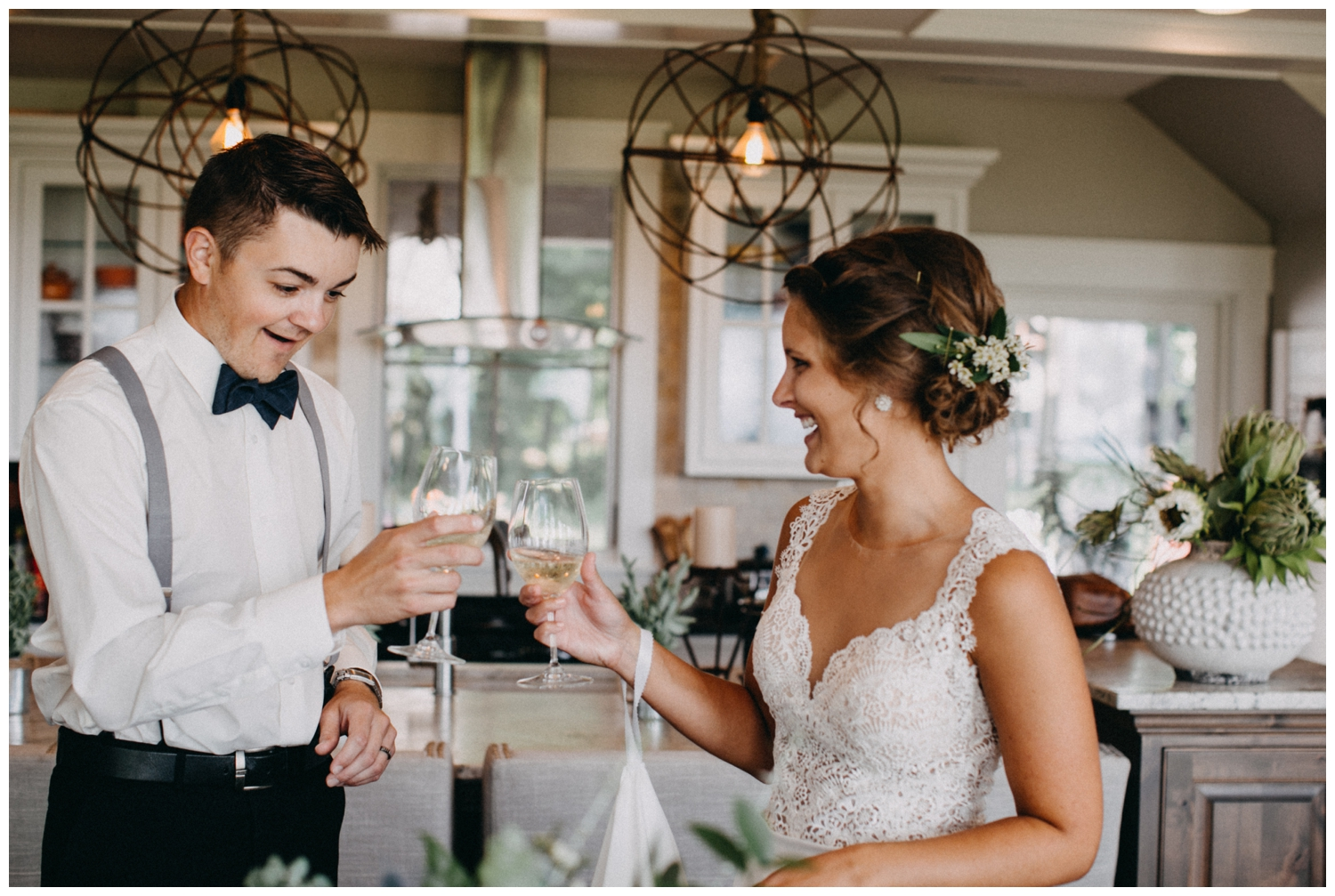 Bride and groom champagne toast at intimate Lake Edward cabin wedding