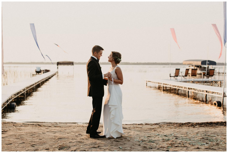 Sunset first dance at beach wedding on Lake Edward