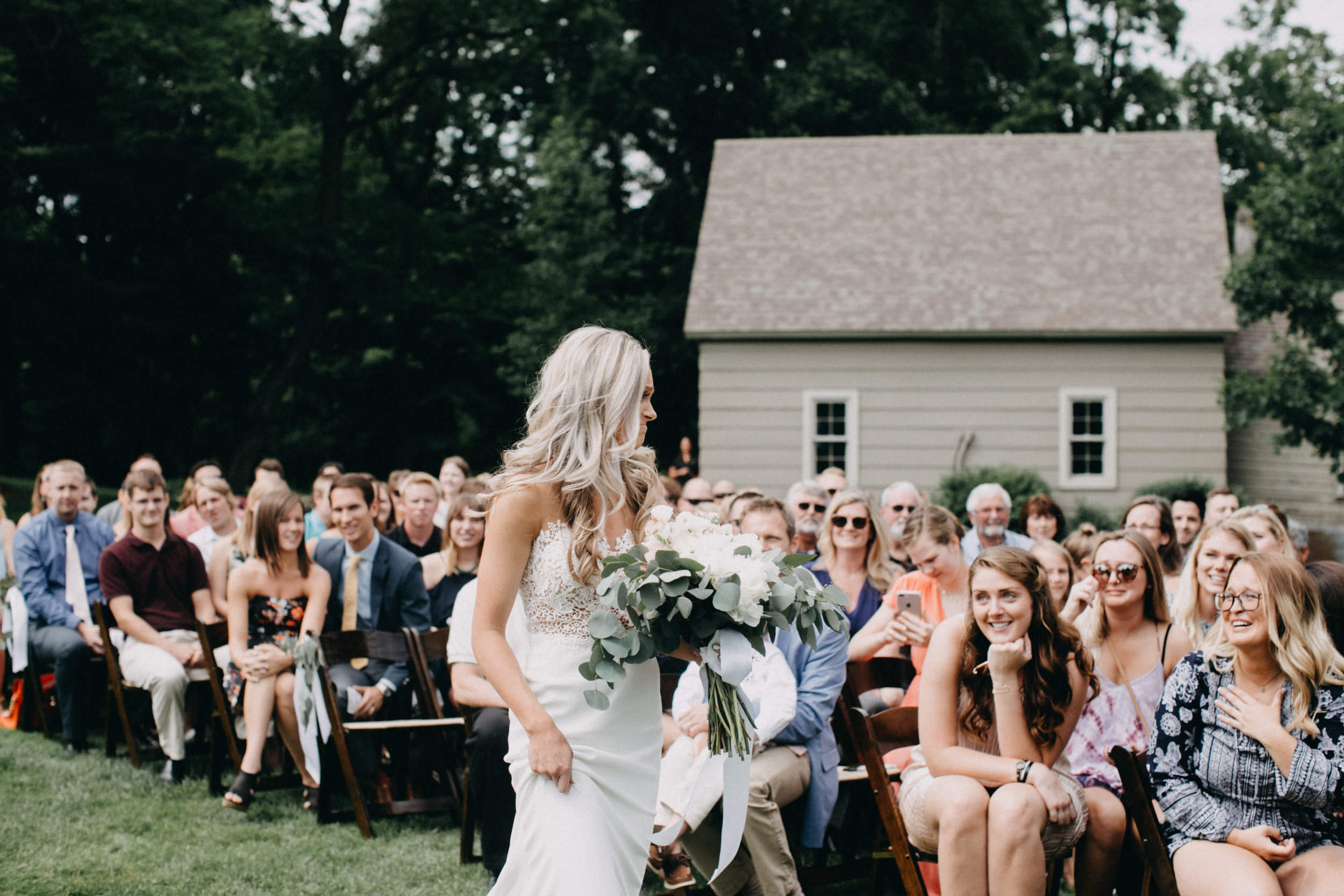 Emotional bride during wedding ceremony at Creekside Farm in Rush City by Britt DeZeeuw